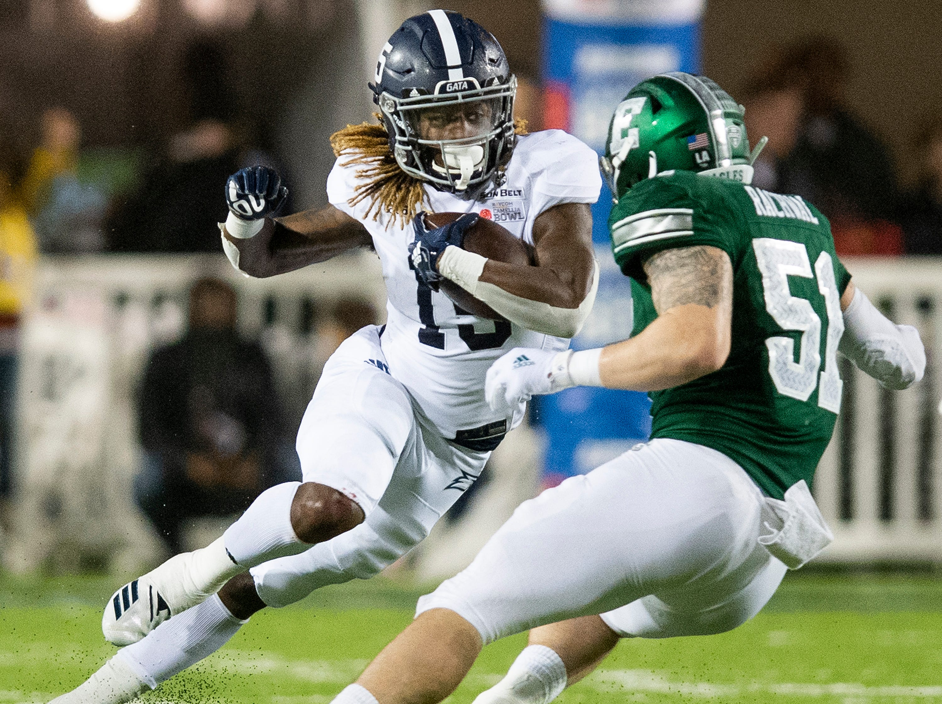 Georgia Southern running back Monteo Garrett (15) carries the ball against Eastern Michigan linebacker Kyle Rachwal (51) during first half action in the Raycom Media  Camellia Bowl held at Cramton Bowl in Montgomery, Ala., on Saturday December 15, 2018.