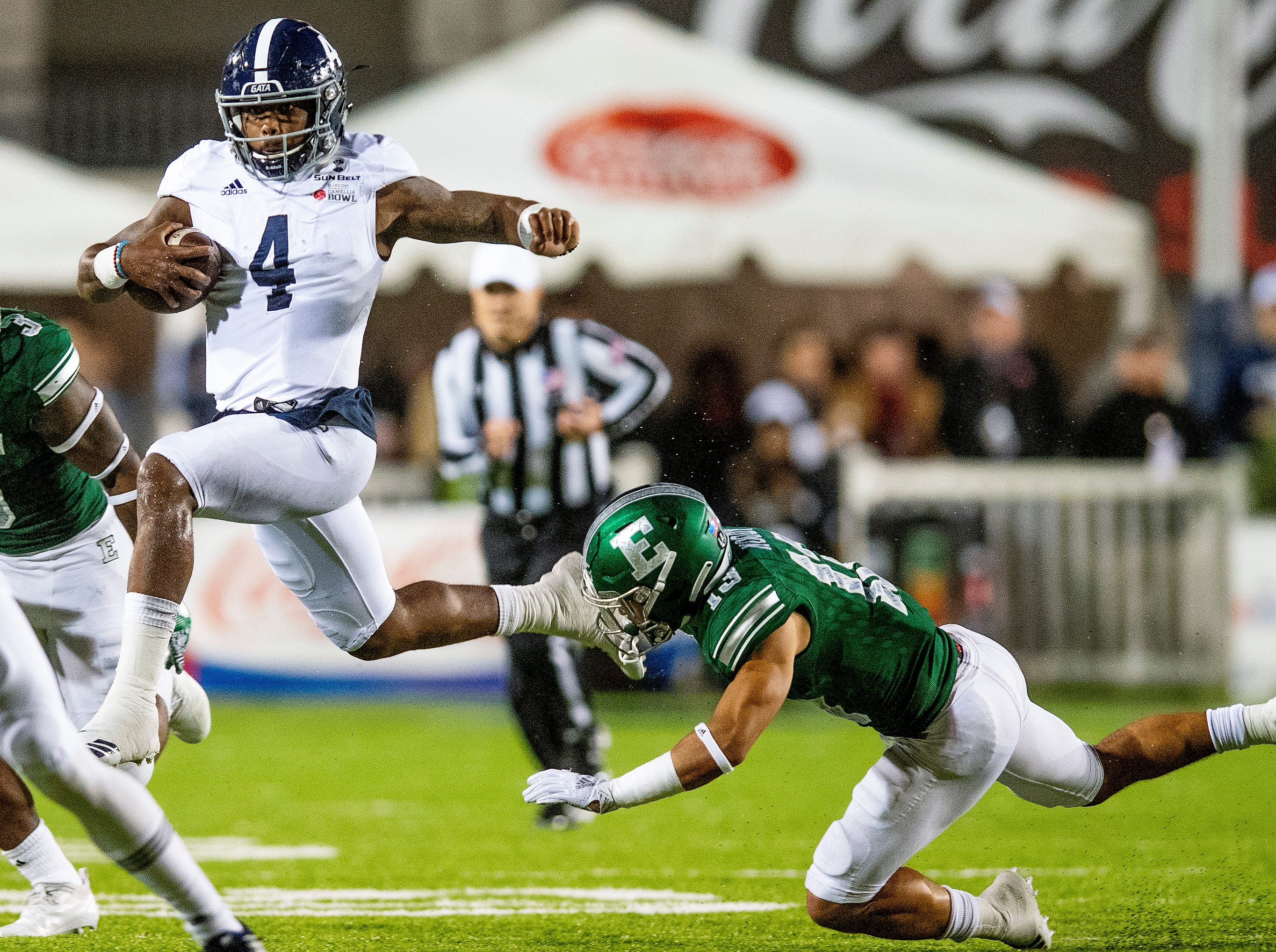 Georgia Southern quarterback Shai Werts (4) breaks free for a long gain against Eastern Michigan defensive back Justin Moody (13) during first half action in the Raycom Media  Camellia Bowl held at Cramton Bowl in Montgomery, Ala., on Saturday December 15, 2018.
