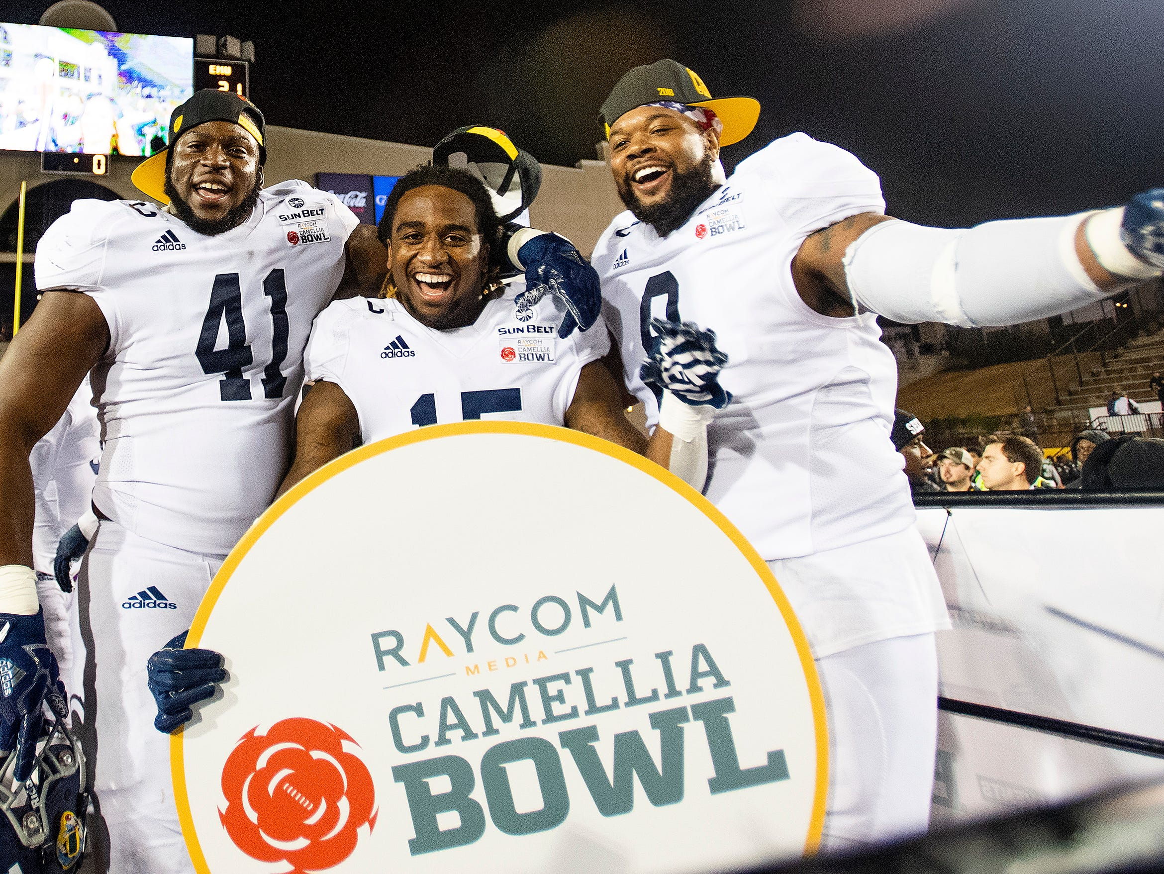 Georgia Southern defensive end Deshon Cooper (41) , ]\ running back Monteo Garrett (15) and defensive end Logan Hunt (9) celebrate after defeating Eastern Michigan in the Raycom Media  Camellia Bowl held at Cramton Bowl in Montgomery, Ala., on Saturday December 15, 2018.