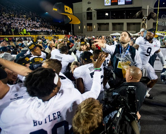 Camellia Bowl Champion caps are passed out after Georgia Southern defeated Eastern Michigan in the Raycom Media  Camellia Bowl held at Cramton Bowl in Montgomery, Ala., on Saturday December 15, 2018.
