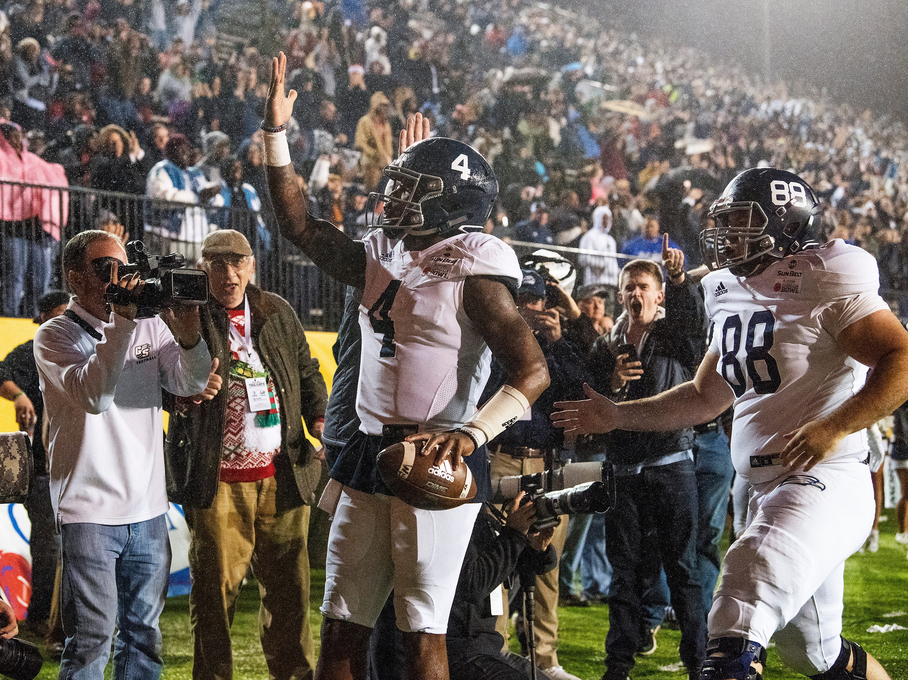 Georgia Southern quarterback Shai Werts (4) celebrates his second touchdown of the first half against Eastern Michigan in the Raycom Media  Camellia Bowl held at Cramton Bowl in Montgomery, Ala., on Saturday December 15, 2018.