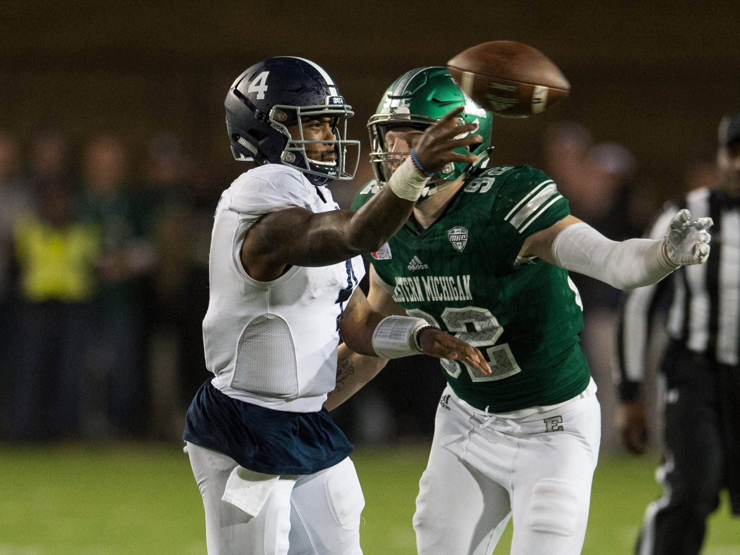 Georgia Southern quarterback Shai Werts (4) throws the ball before he is it by Eastern Michigan defensive lineman Maxx Crosby (92) during the Camellia Bowl at Cramton Bowl in Montgomery, Ala., on Saturday, Dec. 15, 2018. Georgia Southern defeated Eastern Michigan 23-21.