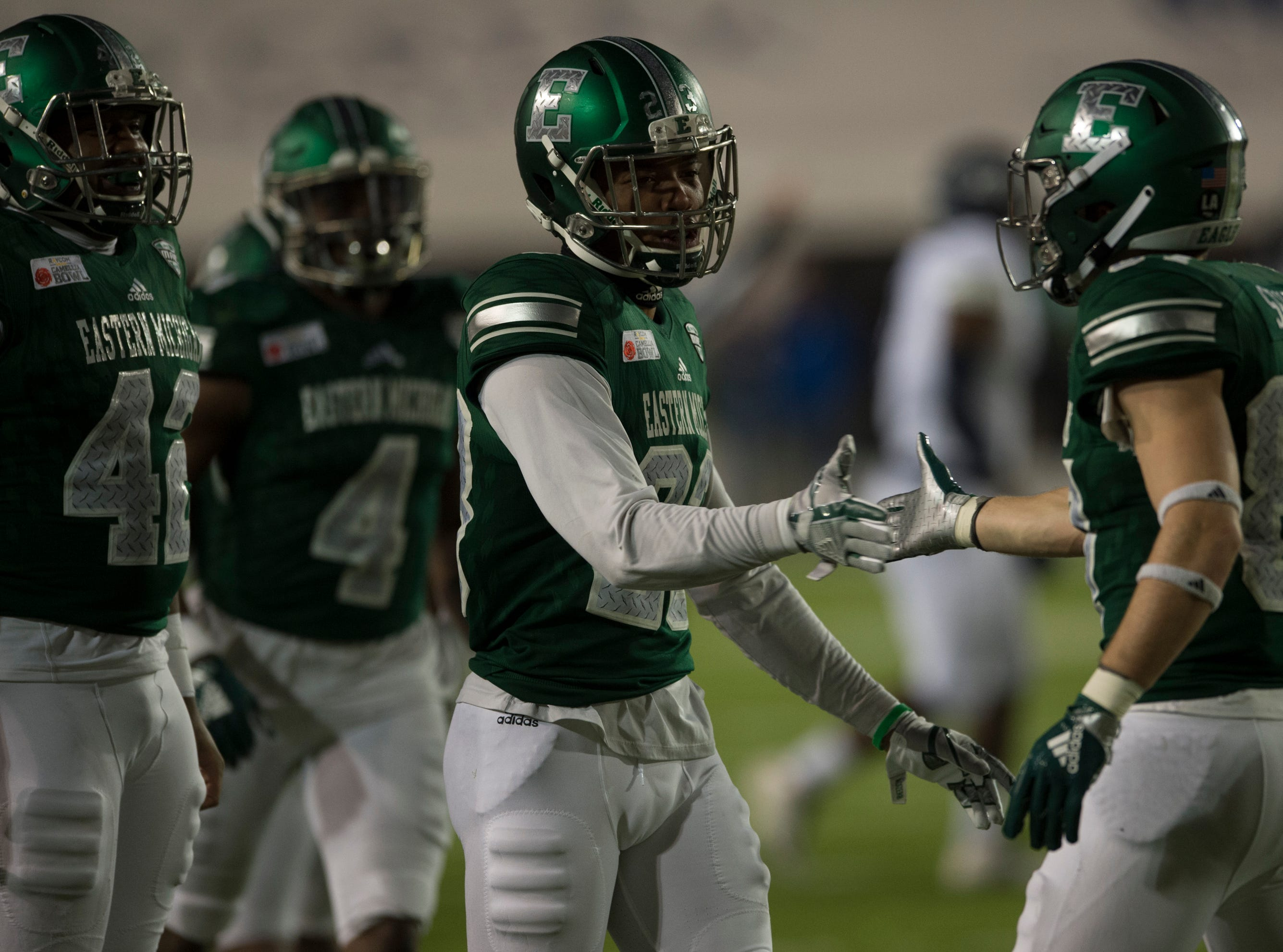 Eastern Michigan defensive back Blake Bogan (23) high fives wide receiver Mathew Sexton (87) after Sexton blocked a punt during the Camellia Bowl at Cramton Bowl in Montgomery, Ala., on Saturday, Dec. 15, 2018. Georgia Southern leads Eastern Michigan 17-7 at halftime.