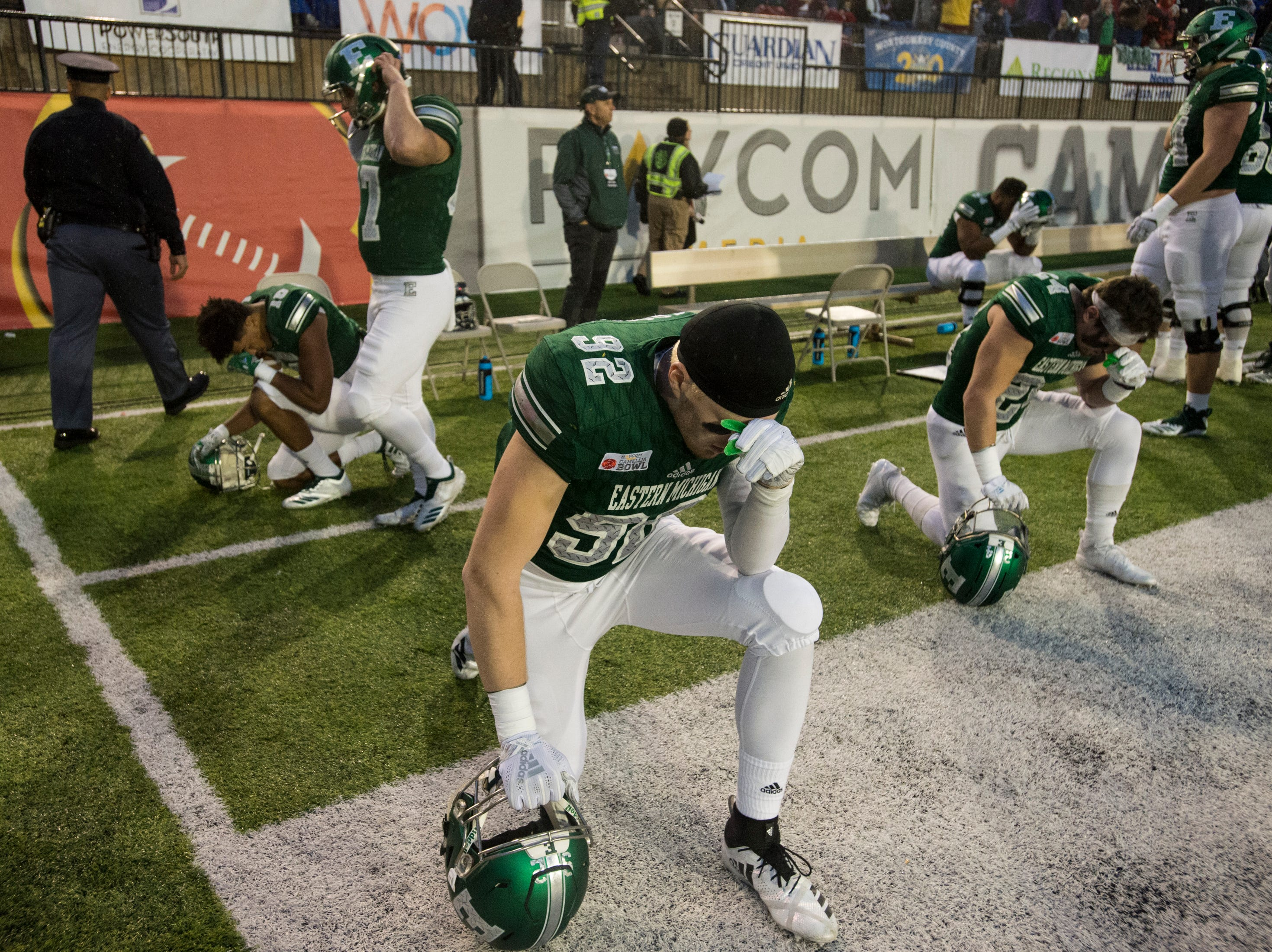 Eastern Michigan players pray before the Camellia Bowl at Cramton Bowl in Montgomery, Ala., on Saturday, Dec. 15, 2018. Georgia Southern leads Eastern Michigan 17-7 at halftime.