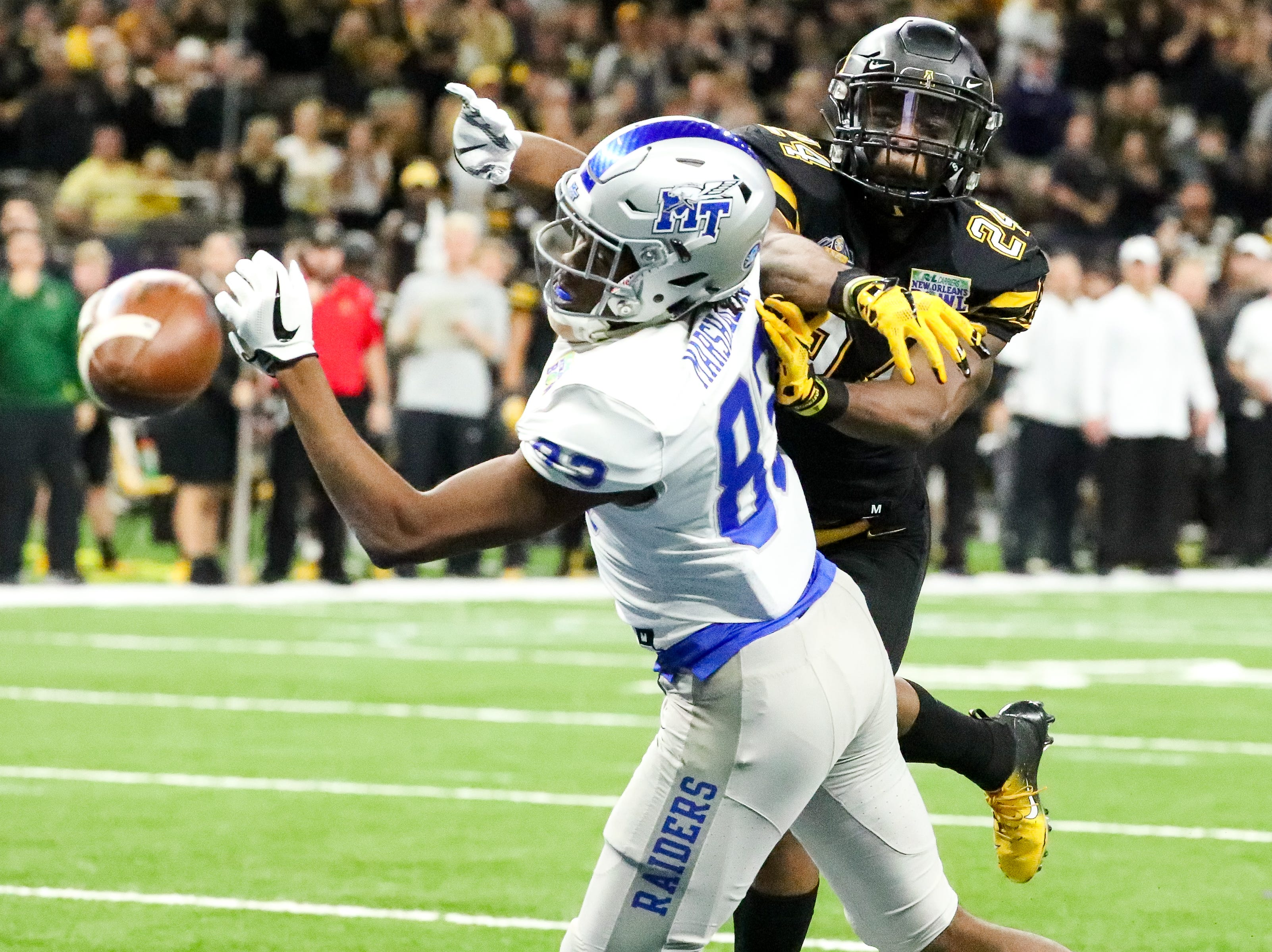 Middle Tennessee Blue Raiders wide receiver Jimmy Marshall (83) misses a catch with pressure from Appalachian State Mountaineers linebacker Akeem Davis-Gaither (24) during the first half at the Mercedes-Benz Superdome Saturday, Dec. 15, 2018, in New Orleans, La.
