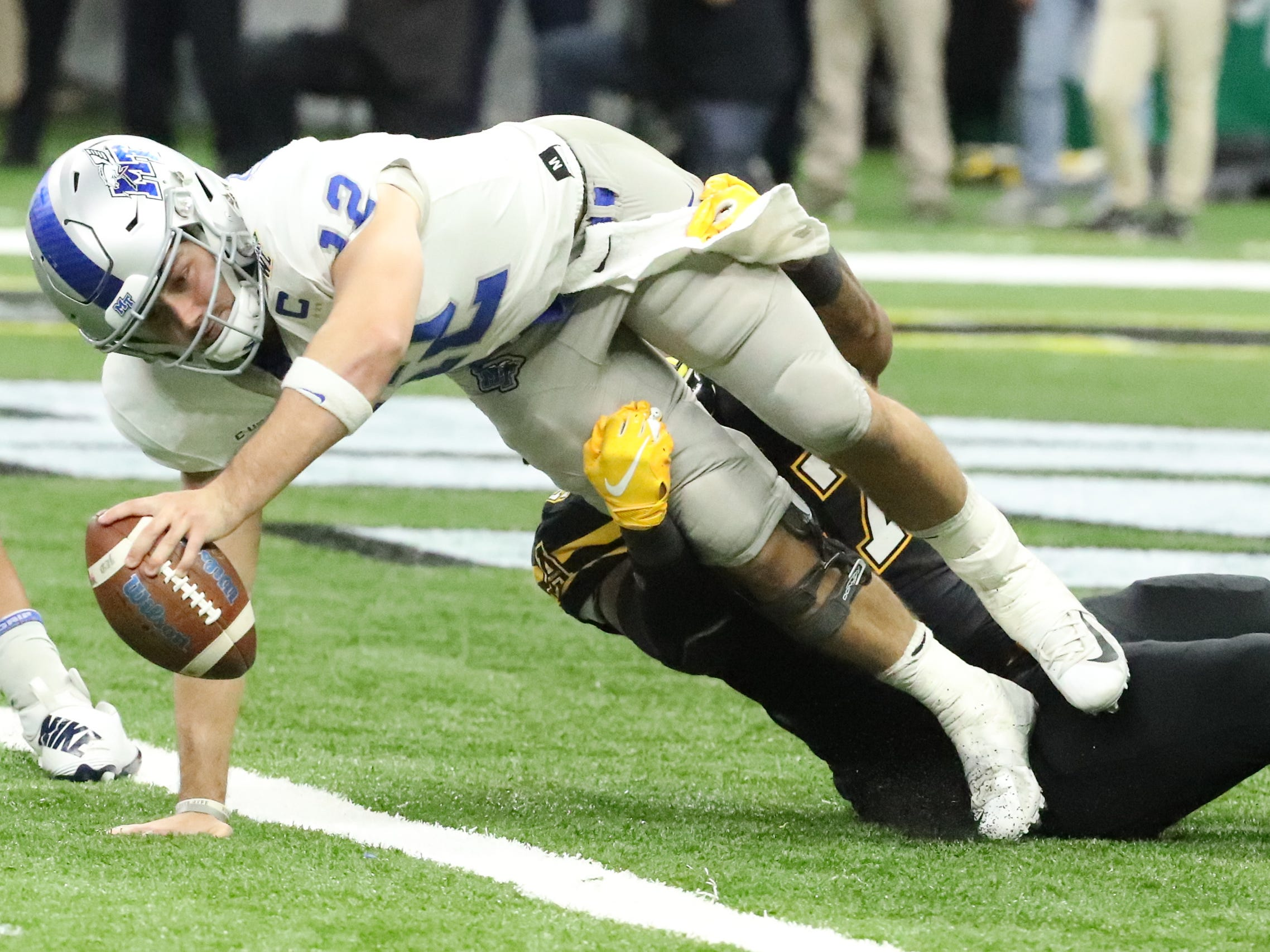 Middle Tennessee Blue Raiders quarterback Brent Stockstill (12) is sacked by Middle Tennessee Blue Raiders wide receiver Reginald Henderson (47) on Saturday, Dec. 15, 2018 during the New Orleans Bowl.