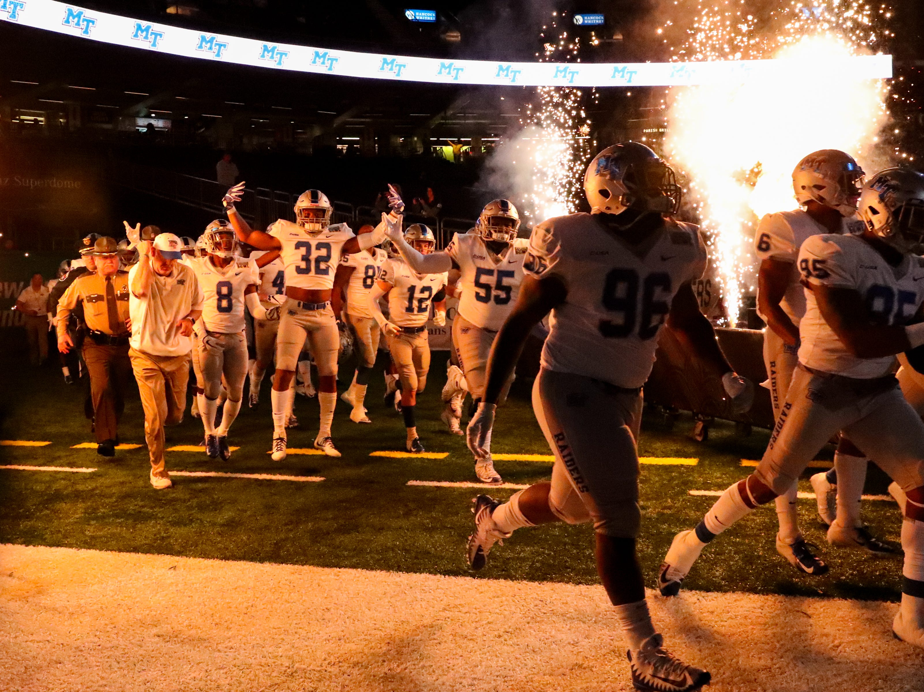 Middle Tennessee Blue Raiders run onto the field before the game at the Mercedes-Benz Superdome Saturday, Dec. 15, 2018, in New Orleans, La.