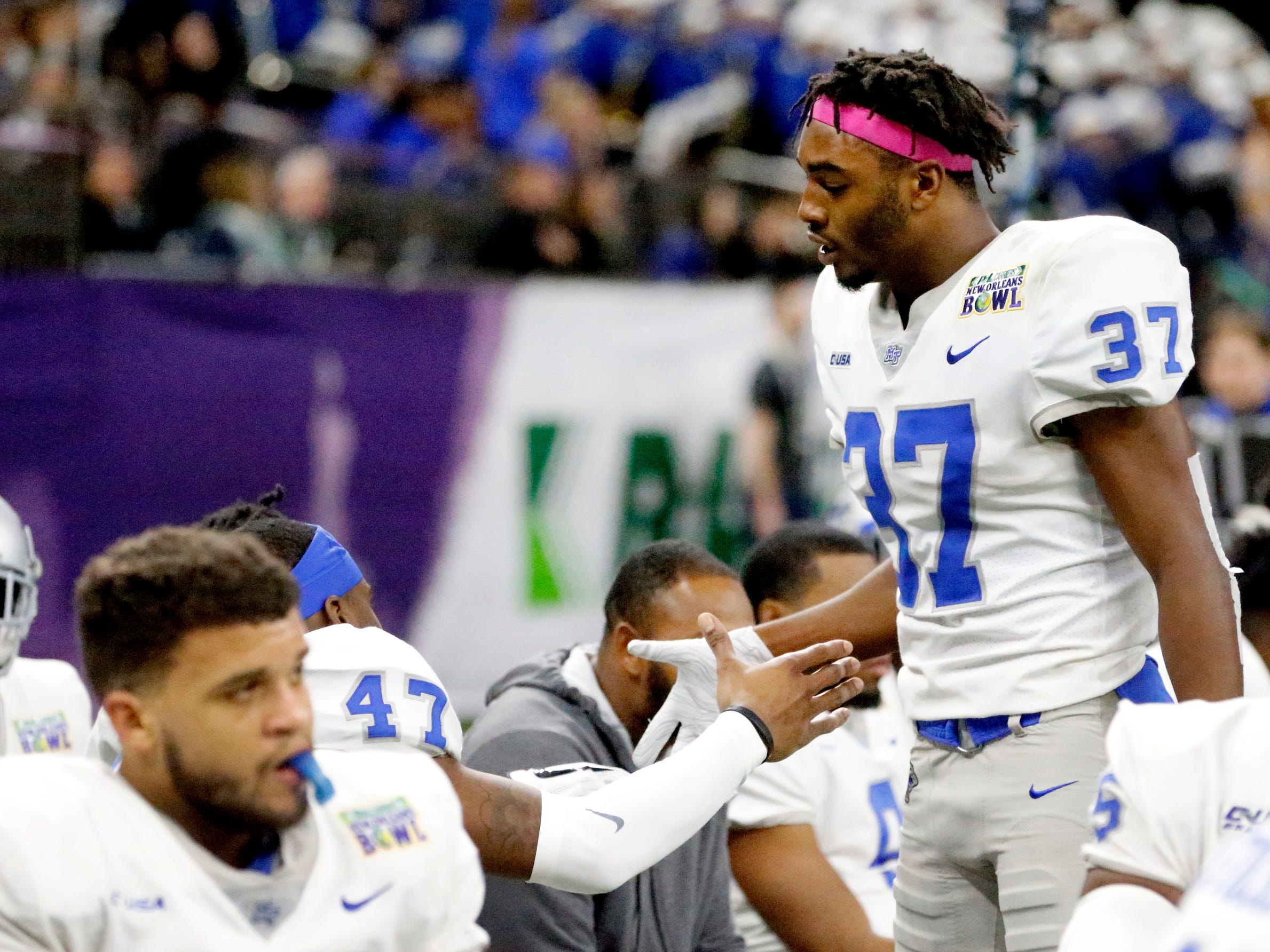 Middle Tennessee Blue Raiders wide receiver Patrick Smith (37) shakes hands with many of the offensive line players near the end of the game as they lose to  Appalachian State on Saturday, Dec. 15, 2018, in the New Orleans Bowl.