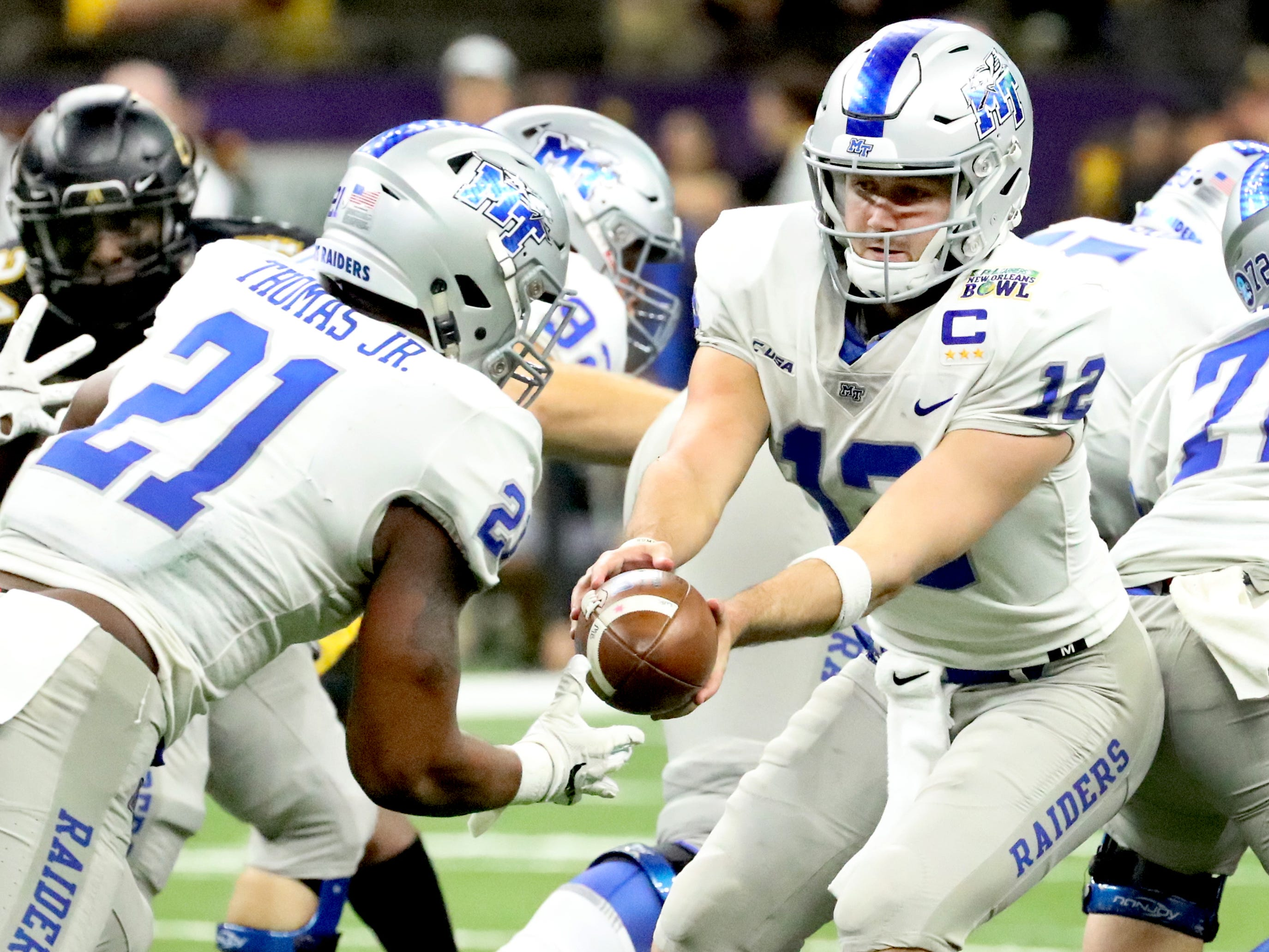 Middle Tennessee Blue Raiders quarterback Brent Stockstill (12) hands ball off to Middle Tennessee Blue Raiders running back Tavares Thomas (21) during the game against Appalachian State Mountaineers on Saturday, Dec. 15, 2018, in the New Orleans Bowl.