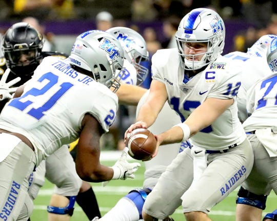 MTSU quarterback Brent Stockstill (12) hands off to running back Tavares Thomas (21) during the New Orleans Bowl against Appalachian State on Dec. 15, 2018.