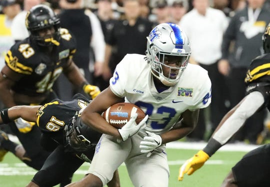 Middle Tennessee Blue Raiders defensive back Wesley Bush (23) runs the ball as Appalachian State Mountaineers defensive back Shaun Jolly (16) misses the tackle on Saturday, Dec. 15, 2018, during the New Orleans Bowl.