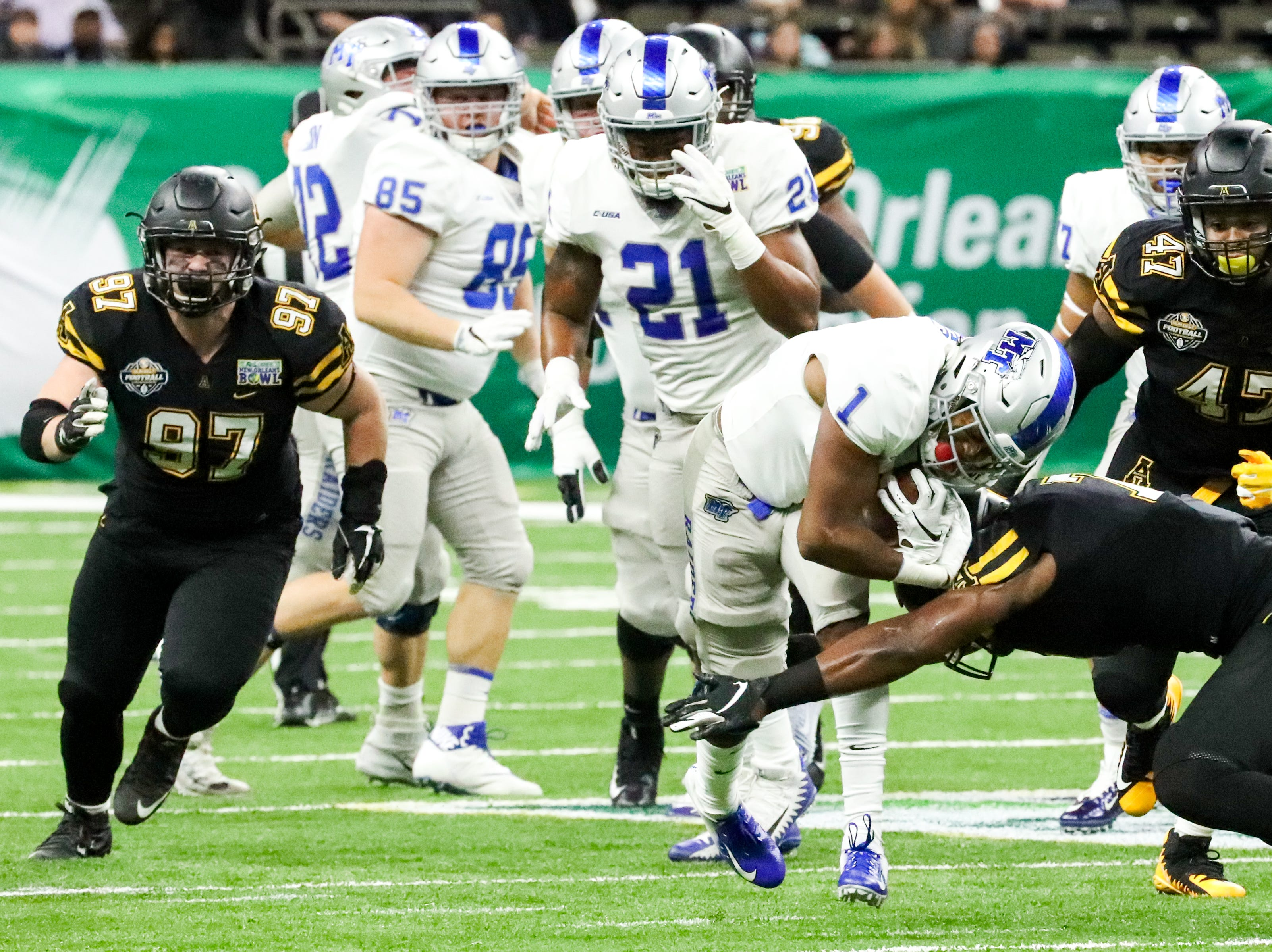 Middle Tennessee Blue Raiders running back Terelle West (1) is tackled by Appalachian State Mountaineers defensive back Josh Thomas (7) during the first half at the Mercedes-Benz Superdome Saturday, Dec. 15, 2018, in New Orleans, La.