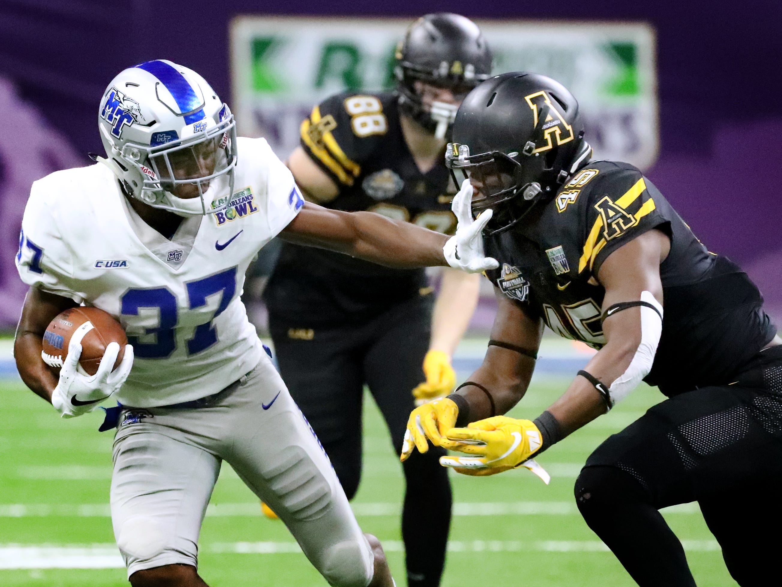 Middle Tennessee Blue Raiders wide receiver Patrick Smith (37) runs the ball as Appalachian State Mountaineers linebacker Trey Cobb (45) moves in for a tackle on Saturday, Dec. 15, 2018, during the New Orleans Bowl.