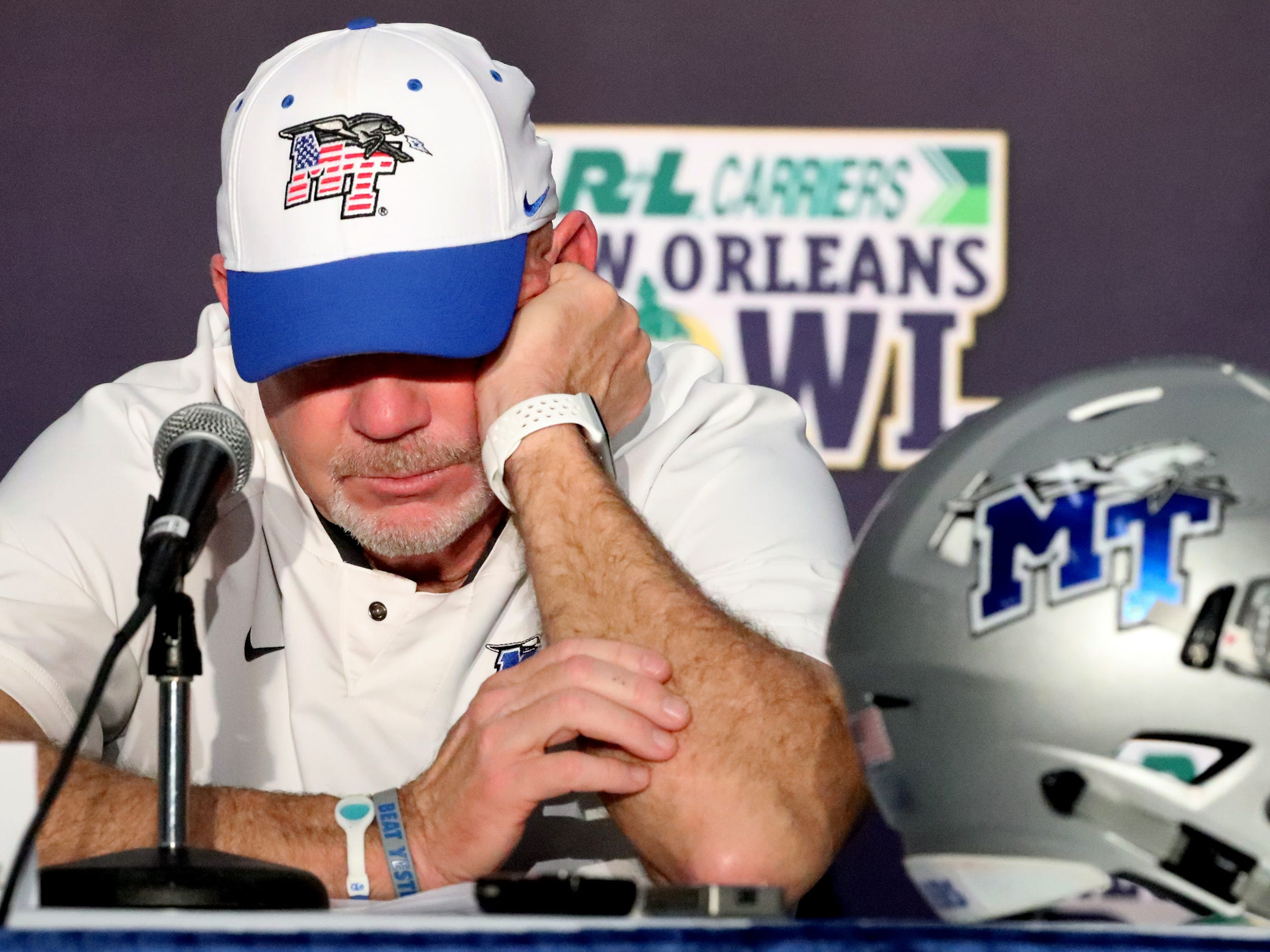 Middle Tennessee Blue Raiders head coach Rick Stockstill listens as the his son Middle Tennessee Blue Raiders quarterback Brent Stockstill (12) is interviewed following the loss to Appalachian State on Saturday, Dec. 15, 2018, during the New Orleans Bowl.