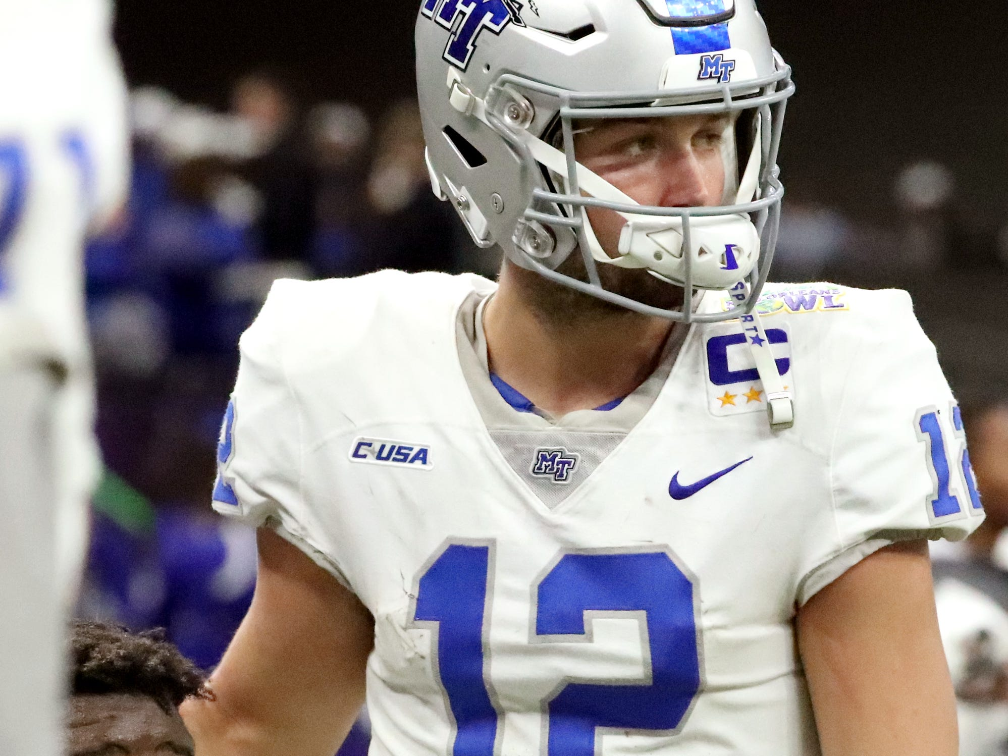 Middle Tennessee Blue Raiders quarterback Brent Stockstill (12) comes over to comfort Middle Tennessee Blue Raiders offensive lineman Carlos Johnson (55) late in the 4th quarter as it looks as if the team will lose to Appalachian State on Saturday, Dec. 15, 2018, during the New Orleans Bowl.