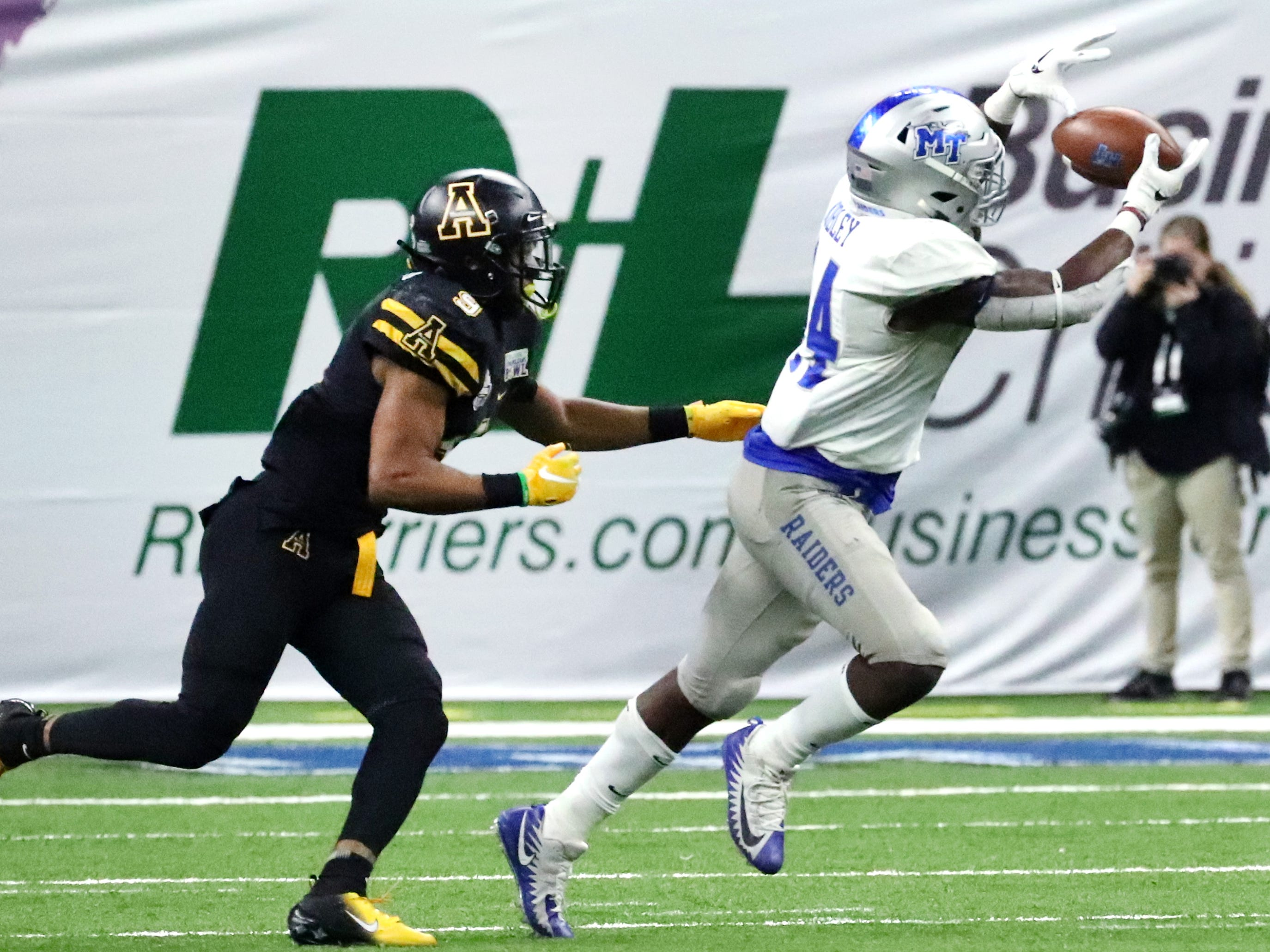 Middle Tennessee Blue Raiders running back Chaton Mobley (44) makes a catch as Appalachian State Mountaineers defensive back Austin Exford (9) moves in for a tackle on Saturday, Dec. 15, 2018, during the New Orleans Bowl.