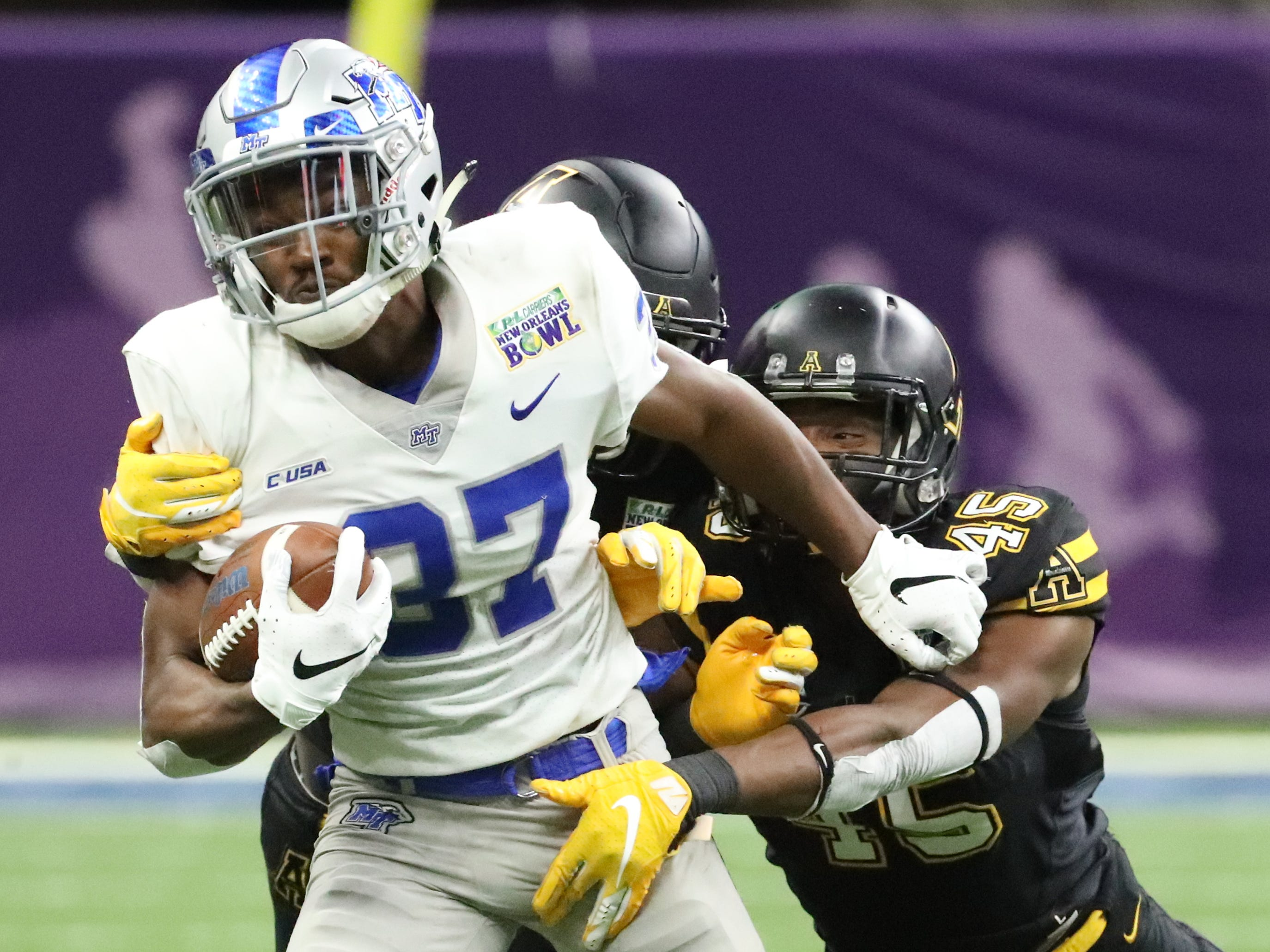 Middle Tennessee Blue Raiders safety Kendricks Gladney (38) runs the ball as Appalachian State Mountaineers linebacker Trey Cobb (45) moves in for a tackle on Saturday, Dec. 15, 2018, during the New Orleans Bowl.
