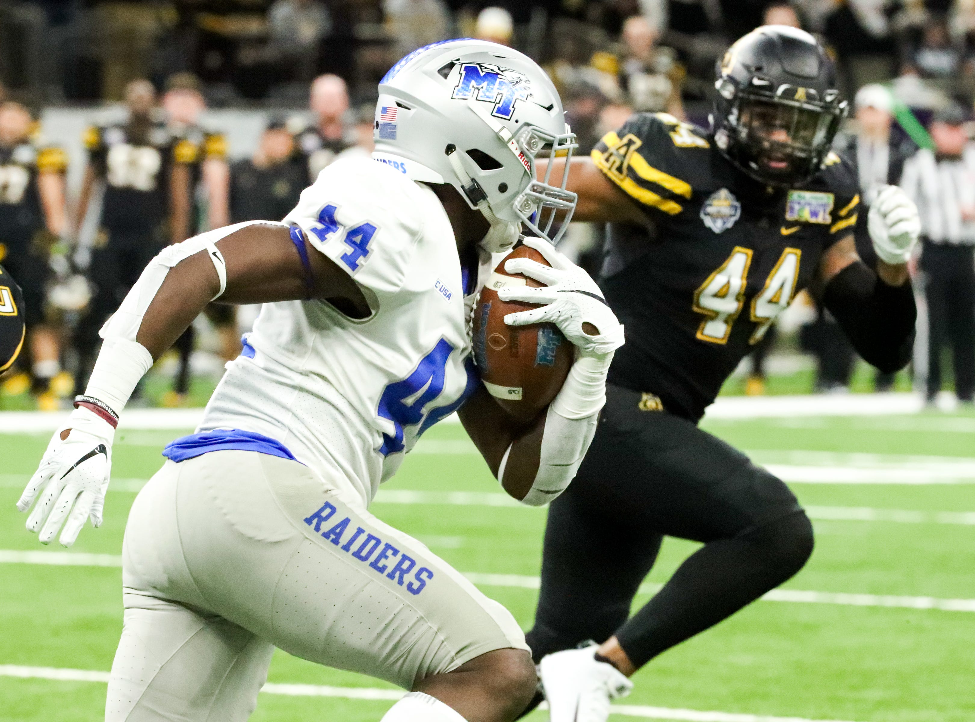 Middle Tennessee Blue Raiders running back Chaton Mobley (44) runs the ball during the first play at the Mercedes-Benz Superdome Saturday, Dec. 15, 2018, in New Orleans, La.
