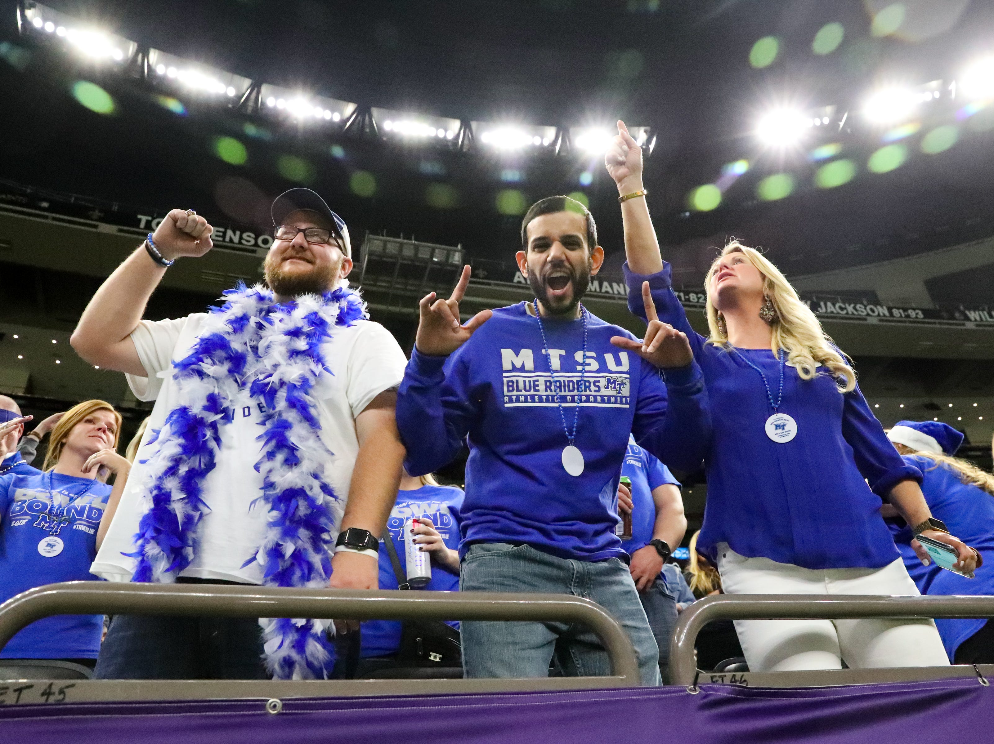 Page Hampton, Ryan Mehta and Shannon Josey cheer for the Middle Tennessee Blue Raiders during the first half at the Mercedes-Benz Superdome Saturday, Dec. 15, 2018, in New Orleans, La.