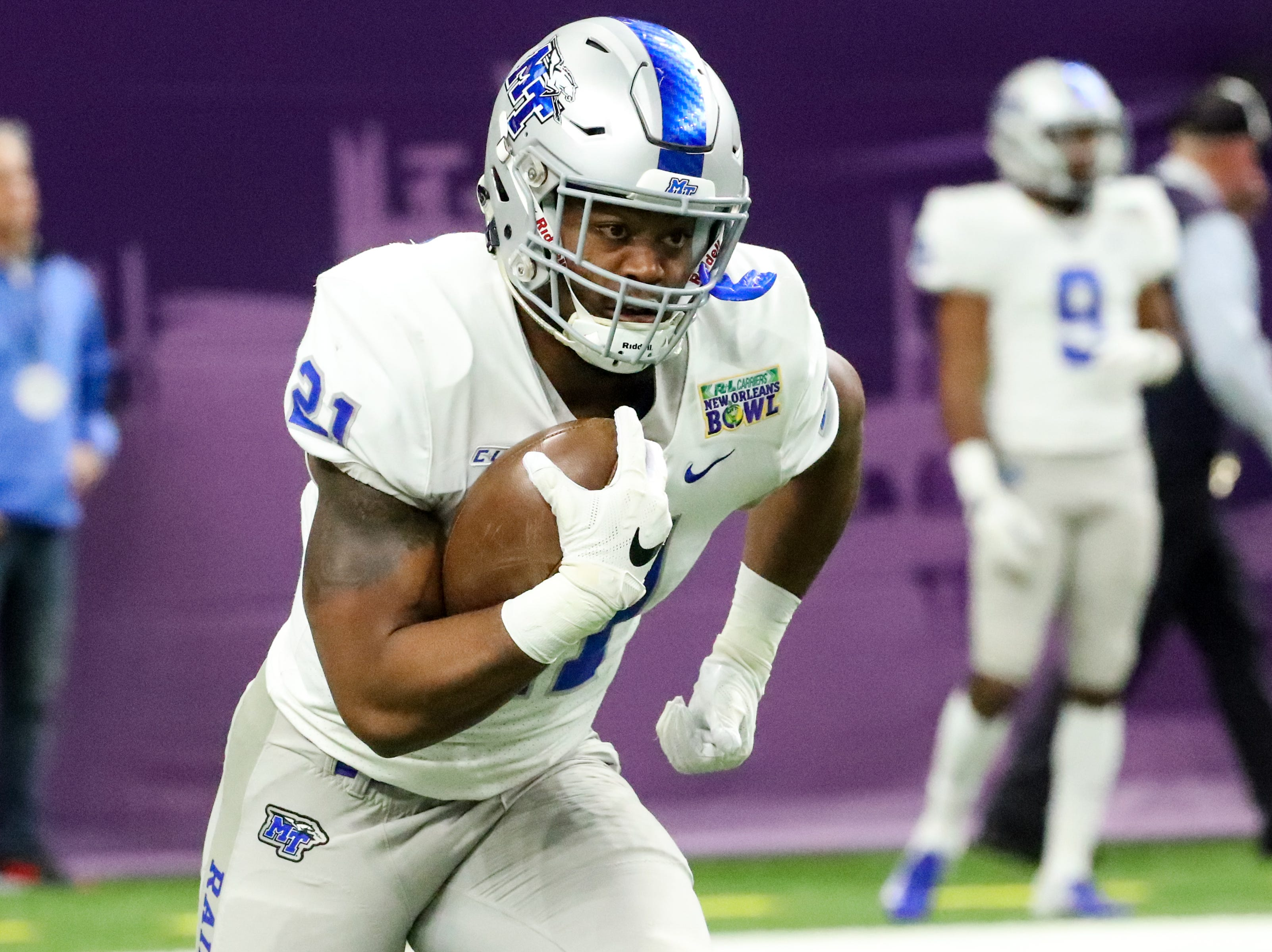 Middle Tennessee Blue Raiders running back Tavares Thomas (21) runs drills before the game at the Mercedes-Benz Superdome Saturday, Dec. 15, 2018, in New Orleans, La.