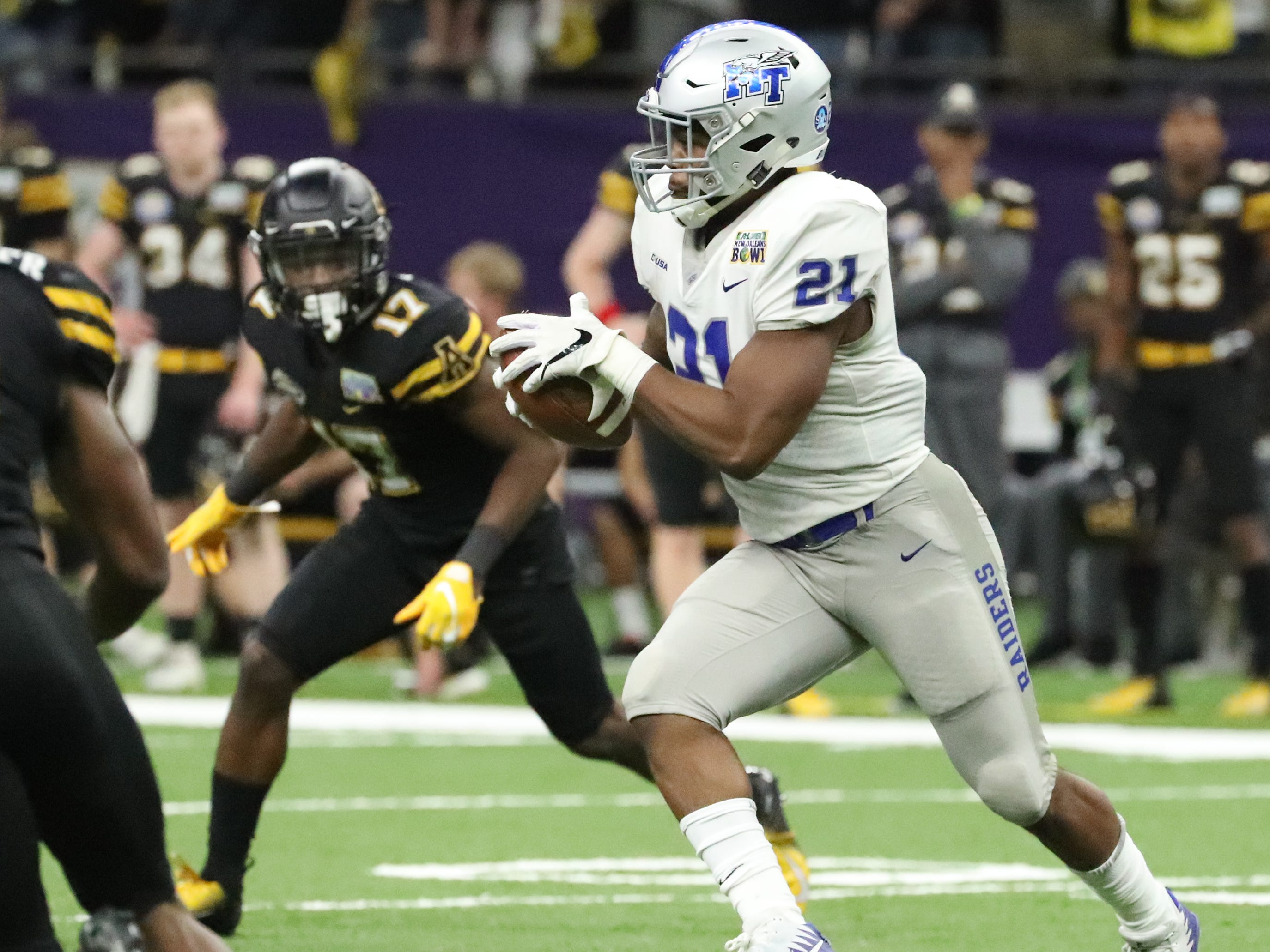 Middle Tennessee Blue Raiders running back Tavares Thomas (21) runs the ball against Appalachian State on Saturday, Dec. 15, 2018 during the New Orleans Bowl.