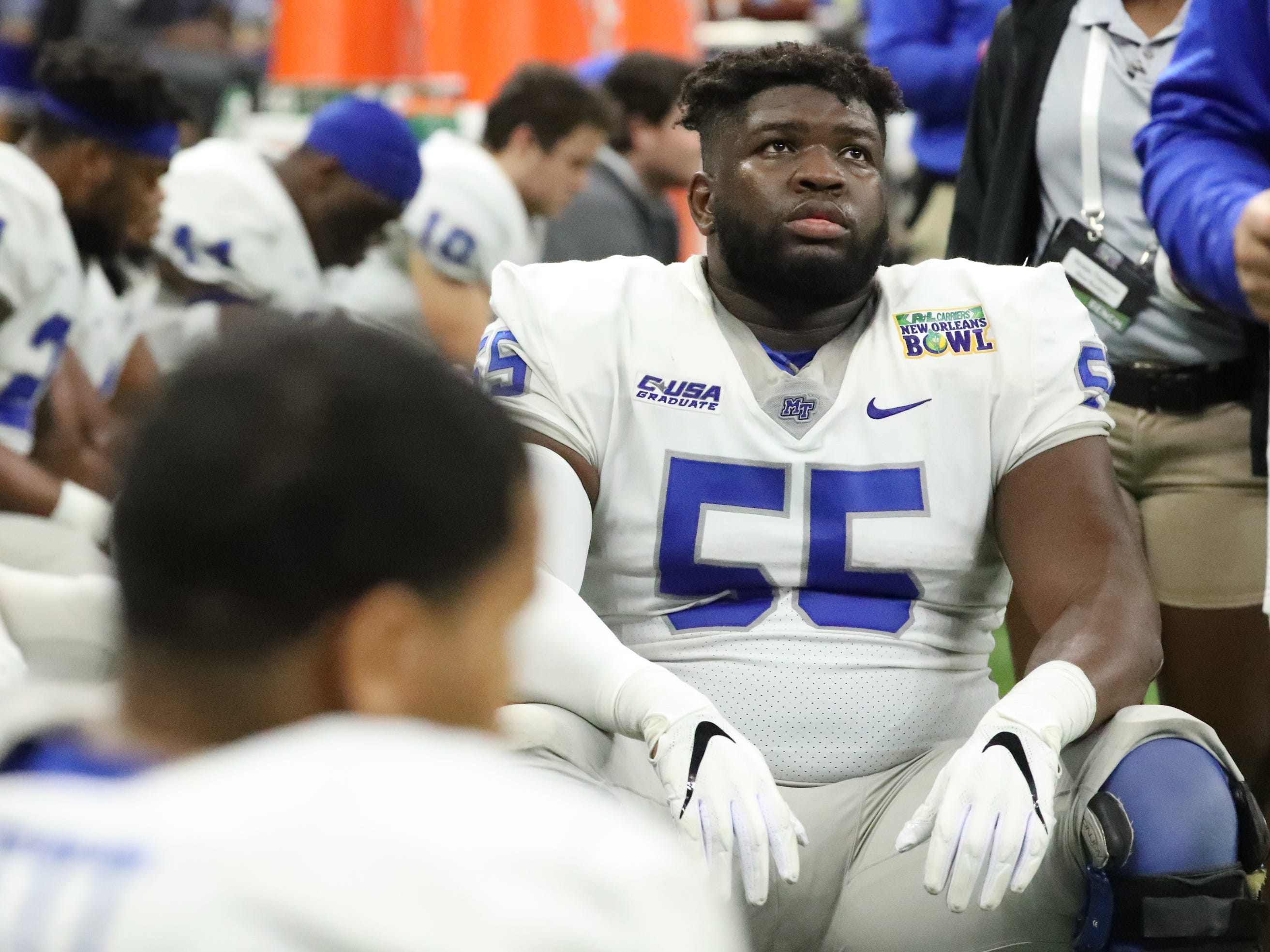 Middle Tennessee Blue Raiders offensive lineman Carlos Johnson (55) looks up at the score while on the sidelines on as they lose to Appalachian State on Saturday, Dec. 15, 2018, during the New Orleans Bowl.