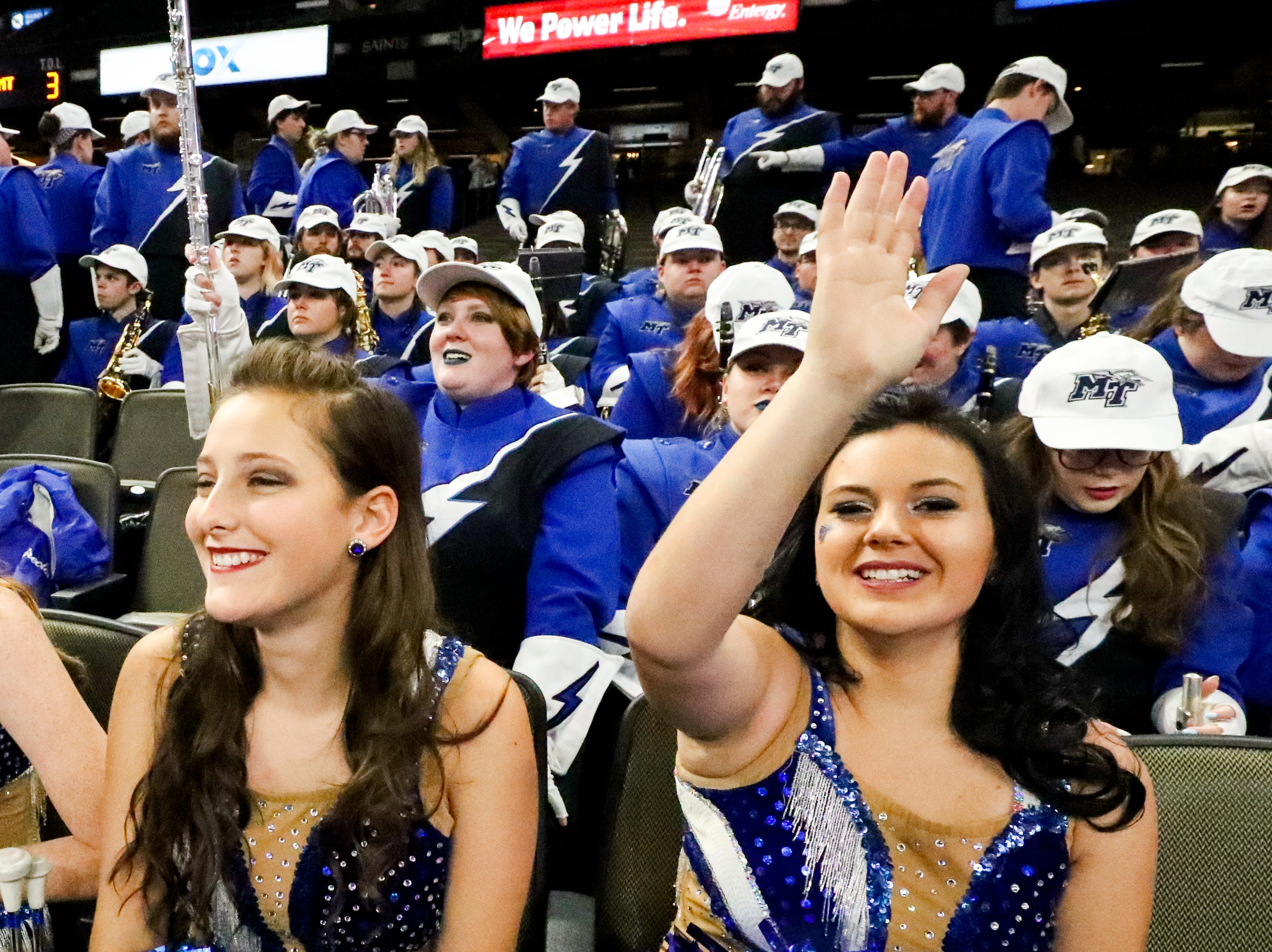 Majorettes sit with the band before the game at the Mercedes-Benz Superdome Saturday, Dec. 15, 2018, in New Orleans, La.