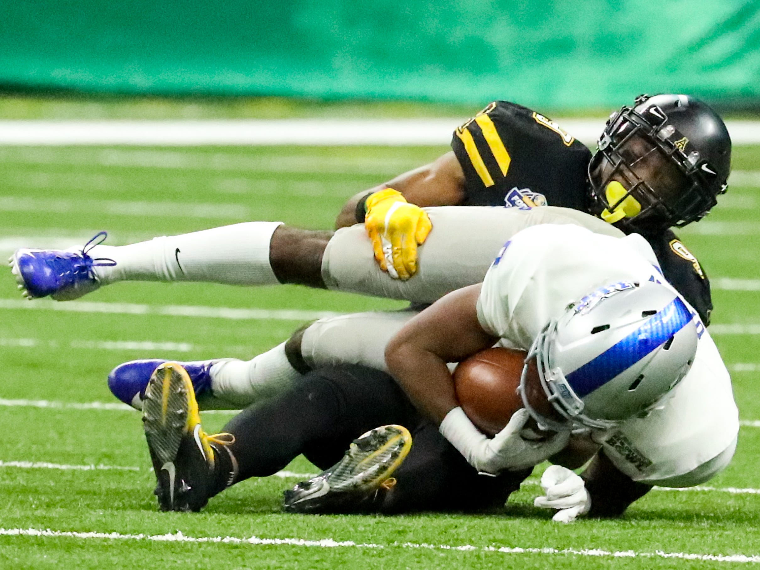 Middle Tennessee Blue Raiders wide receiver Isiah Upton (9) is tackled by Appalachian State Mountaineers defensive back Austin Exford (9) during the first half at the Mercedes-Benz Superdome Saturday, Dec. 15, 2018, in New Orleans, La.