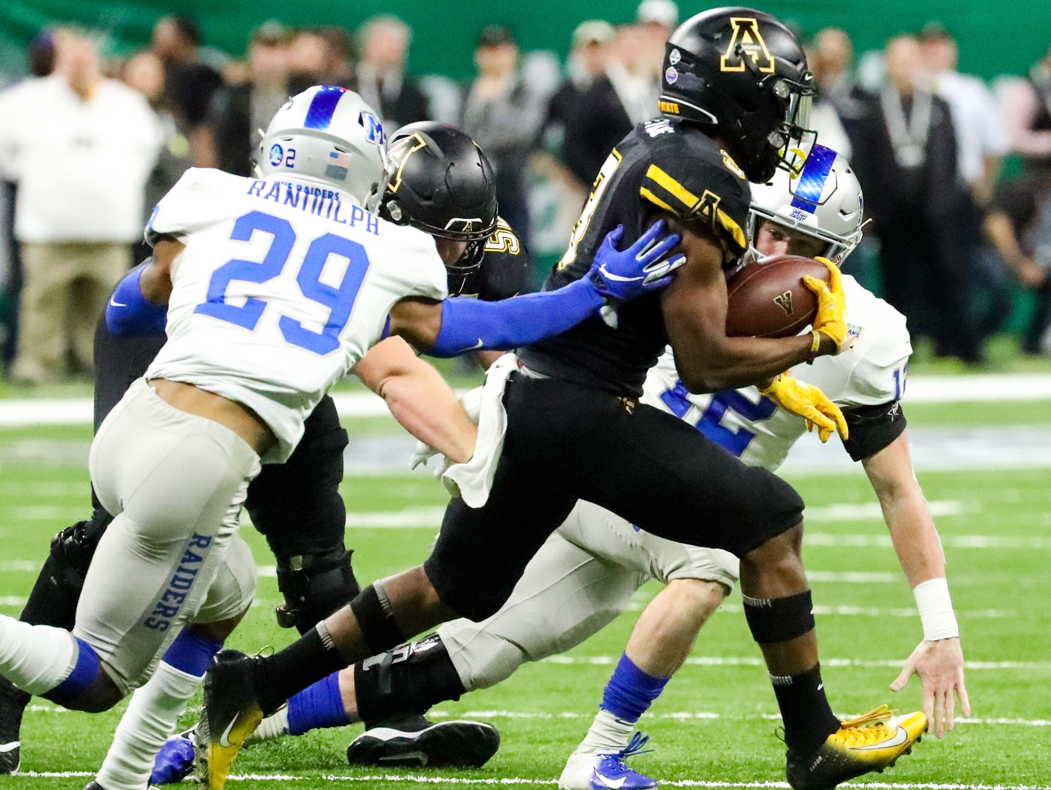 Appalachian State Mountaineers running back Darrynton Evans (3) runs the ball while missing tackles from Middle Tennessee Blue Raiders during the first half at the Mercedes-Benz Superdome Saturday, Dec. 15, 2018, in New Orleans, La.