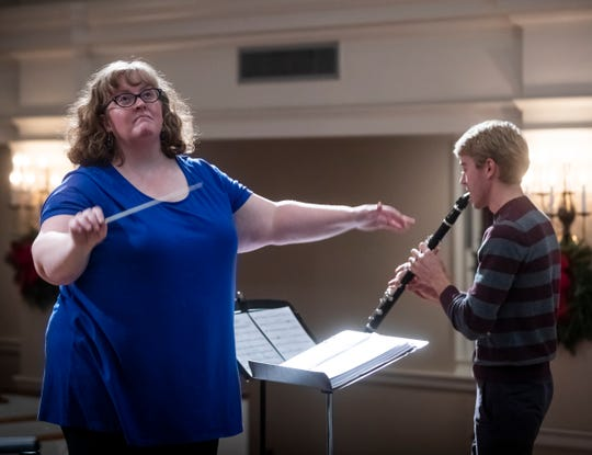 """Melissa Emerson, the director of music ministries at Calvary United Methodist Church, conducts leads practice Dec. 12, 2018. """"Music always touches so much deeper than we even really conceive and especially music that has long-standing traditions,"""" she said."""
