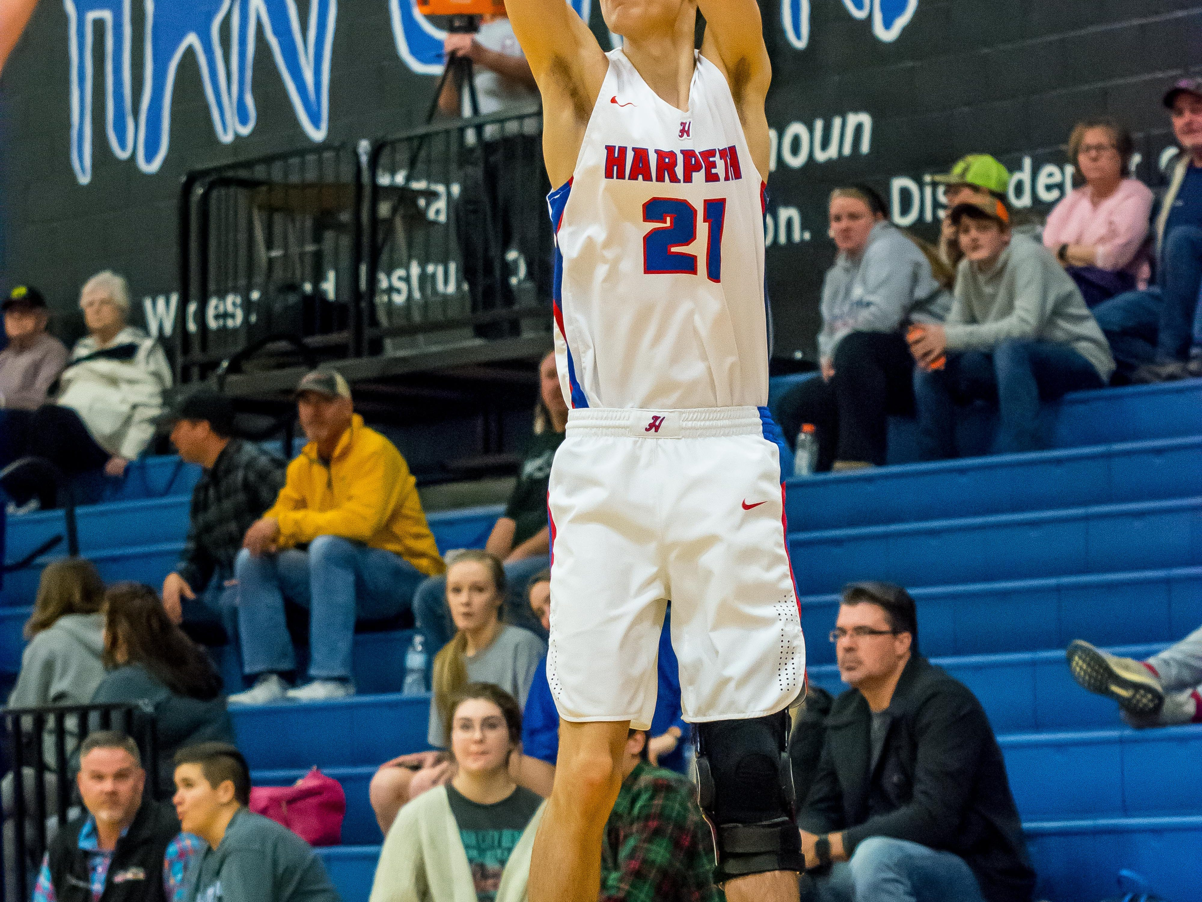 Harpeth shooter Carter Hutchinson with a three against Greenbrier.