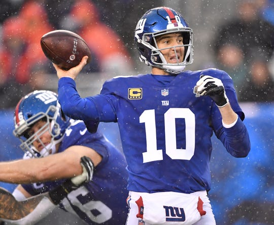 Giants quarterback Eli Manning (10) passes against the Tennessee Titans during the second quarter at MetLife Stadium Sunday, Dec. 16, 2018.