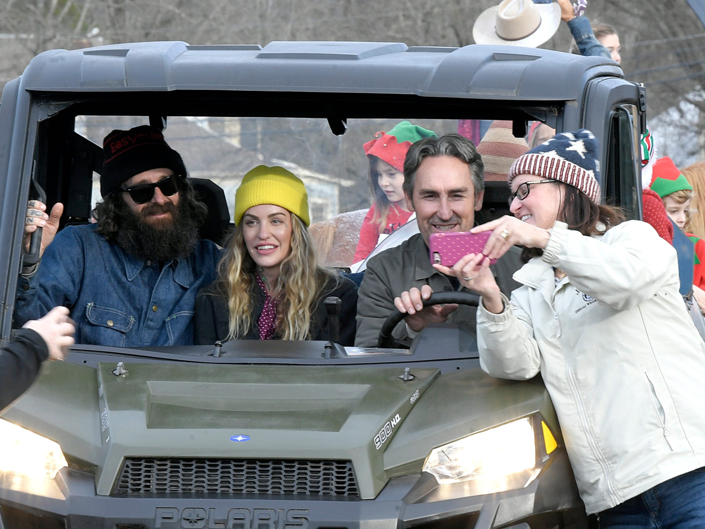 People take selfies with Mike Wolfe from the show American Pickers during the Leiper's Fork Christmas Parade on Saturday, Dec. 15, 2018.