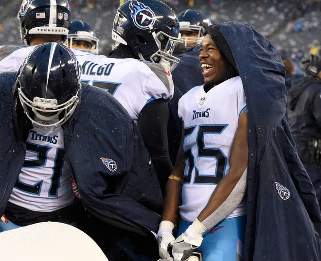 Titans linebacker Jayon Brown (55) celebrates late in the game Sunday.
