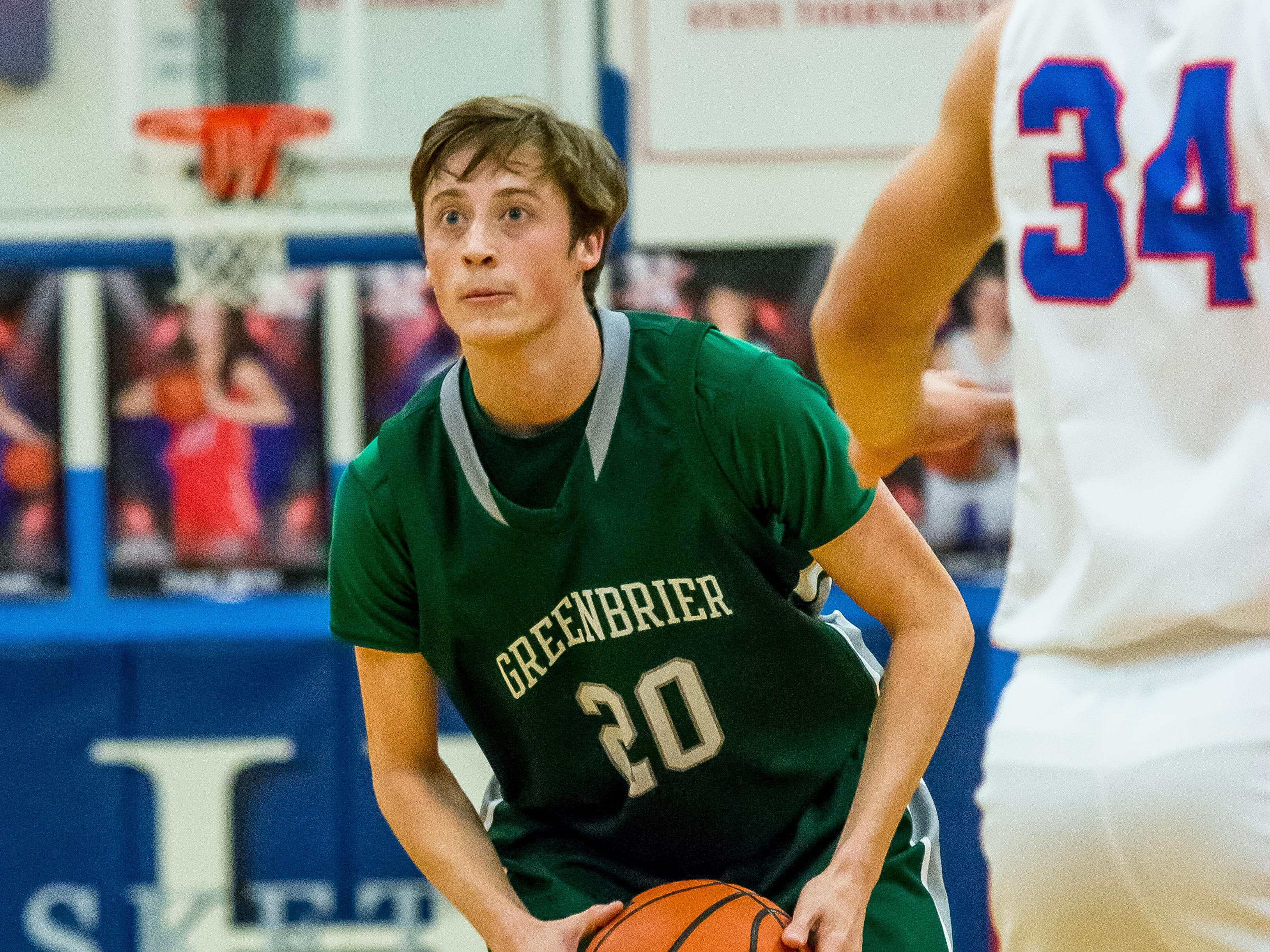 Greenbrier's Dallas Polen looks for a teammate to pass to against Harpeth.