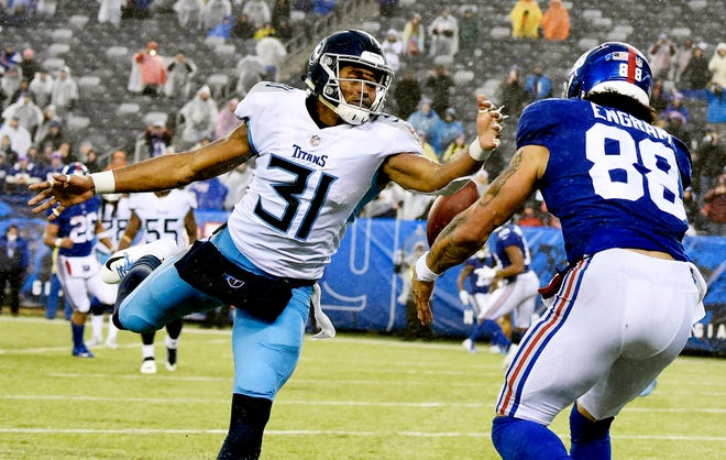 Titans safety Kevin Byard (31) breaks up a pass intended for Giants tight end Evan Engram (88) in the fourth quarter Sunday.