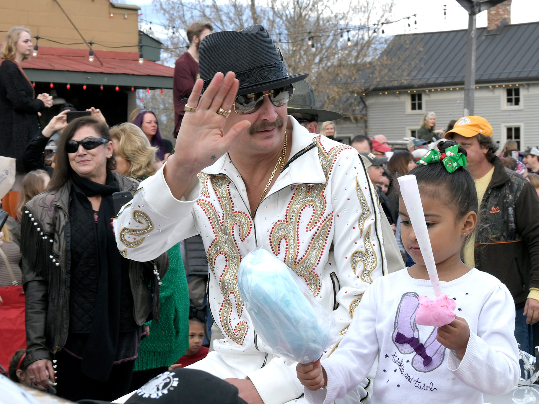 Kid Rock waves to the crowd as he rides in the Leiper's Fork Christmas Parade on Saturday, Dec. 15, 2018.