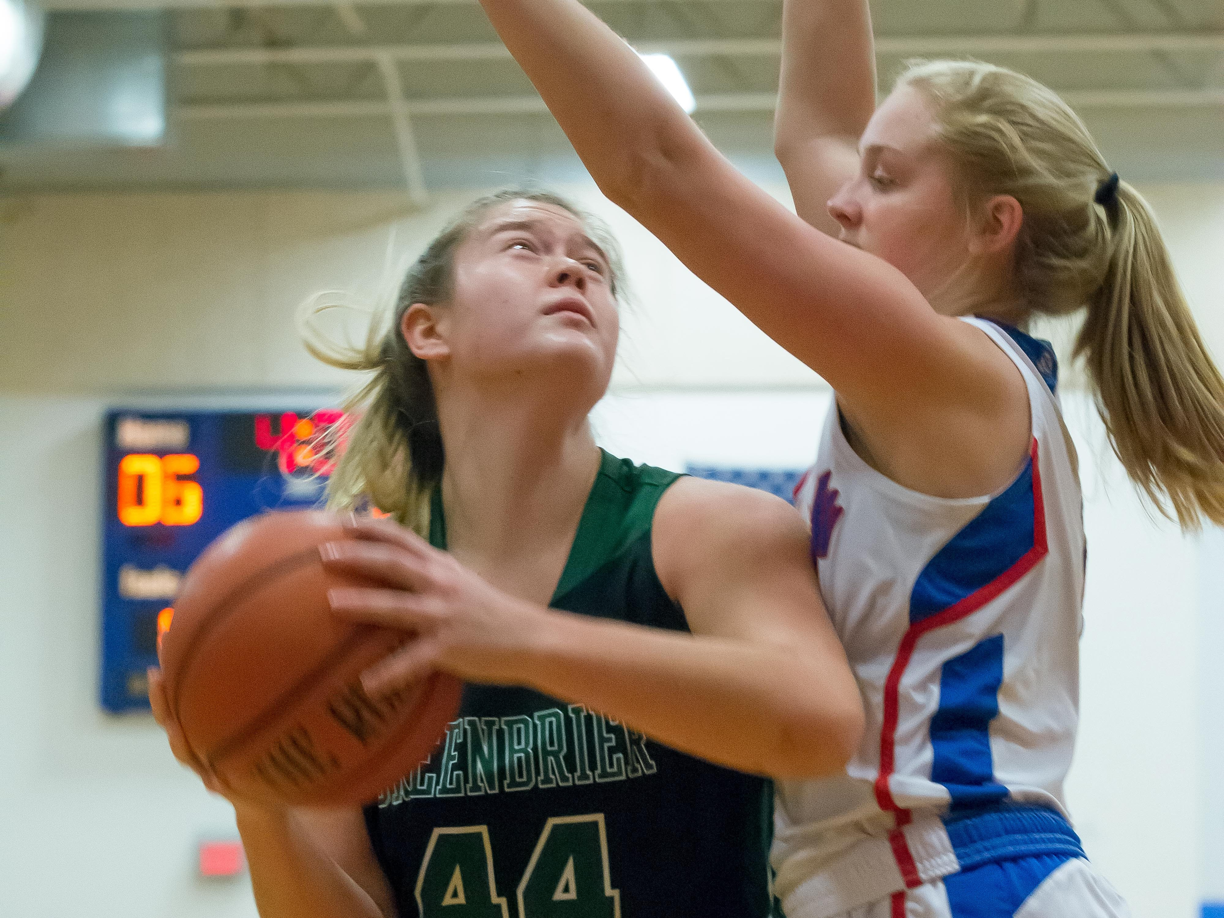 Greenbrier's Kayla Conquest tries to get a shot off against a Harpeth defender.