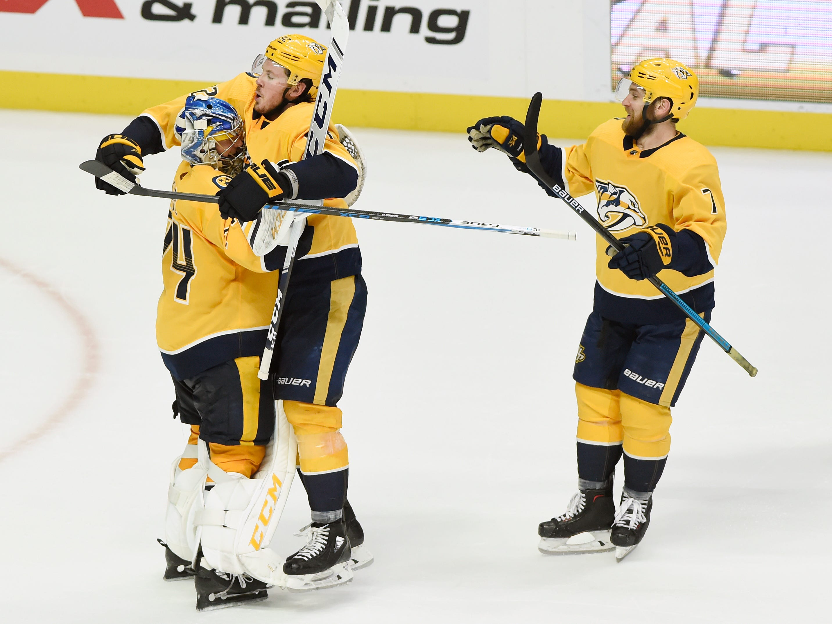 Dec 15: Predators 2, Devils 1 (OT) -- Nashville Predators center Ryan Johansen (92) celebrates with goaltender Juuse Saros (74) after the team's win against the New Jersey Devils in a shootout of an NHL hockey game Saturday, Dec. 15, 2018, in Nashville, Tenn. Predators defenseman Yannick Weber (7) joins in. The Predators won 2-1.
