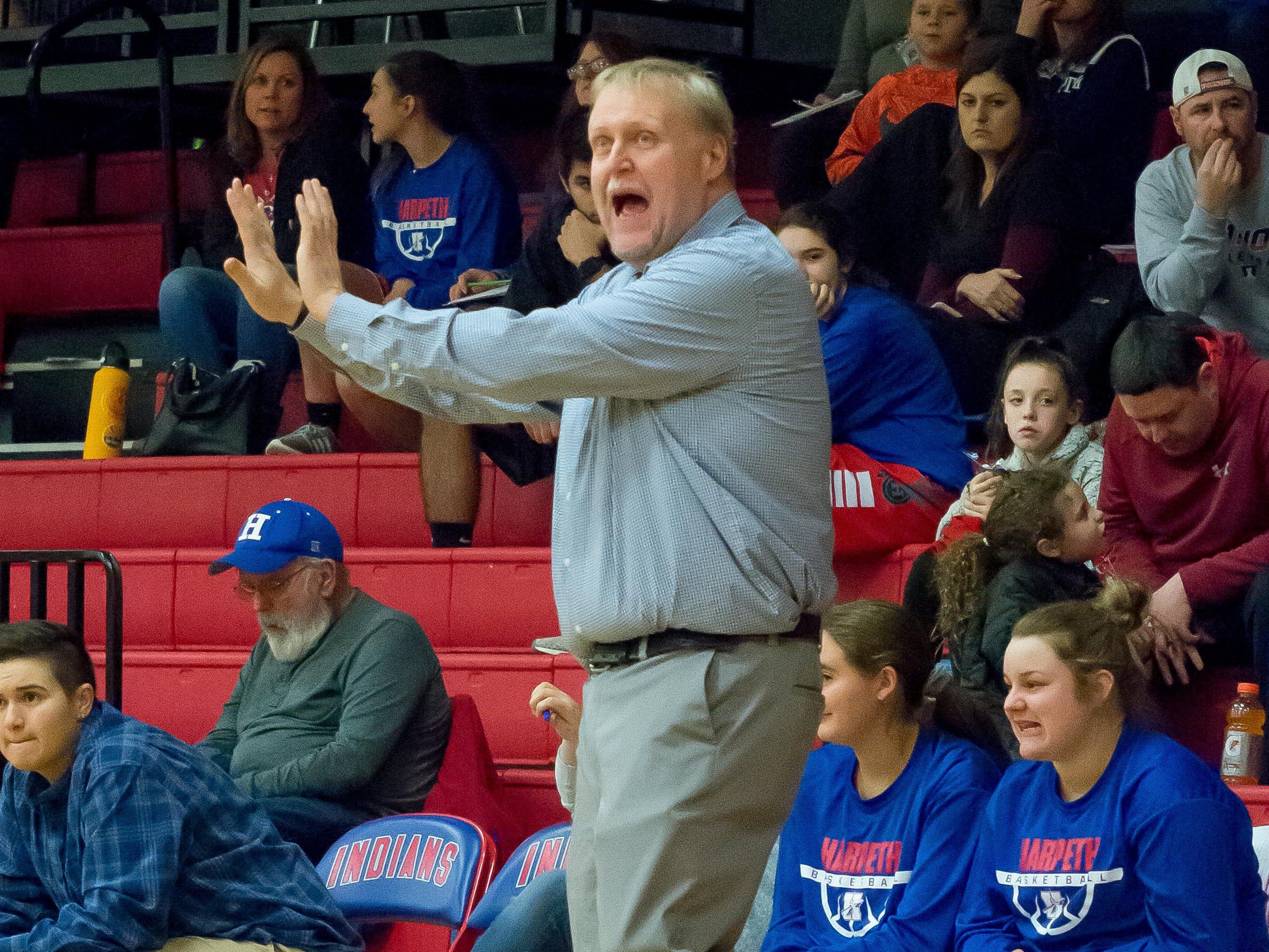 Harpeth girls basketball coach Jimmy Mitchell coaches his team against Greenbrier.