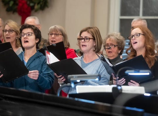 Members of the choir sing during Calvary United Methodist Church's music practice Dec. 12, 2018.