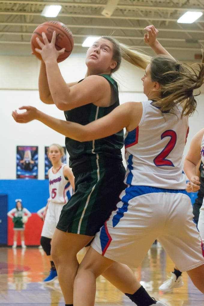 Greenbrier's Kayla Conquest goes up for a shot against Harpeth. She led Greenbrier with 17 points.