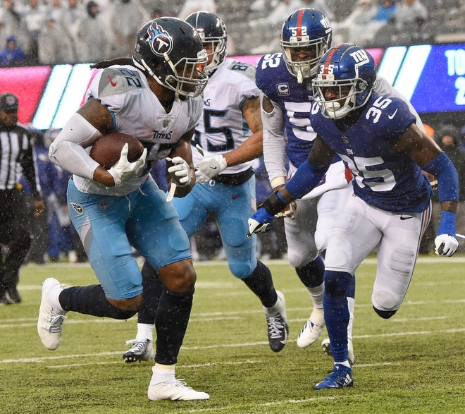 Titans running back Derrick Henry (22) runs in for a touchdown in the third quarter at MetLife Stadium Sunday, Dec. 16, 2018, in East Rutherford, N.J.