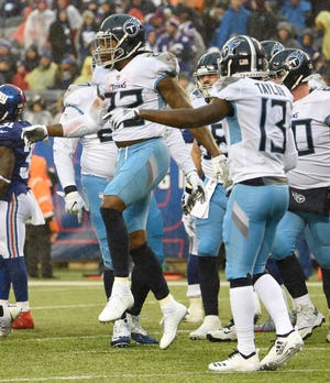 Titans running back Derrick Henry (22) celebrates his touchdown in the first quarter Sunday at MetLife Stadium.