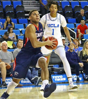 Belmont's Kevin McClain drives for a basket against UCLA's Moses Brown in Saturday's game at Pauley Pavilion, which Belmont won 74-72.