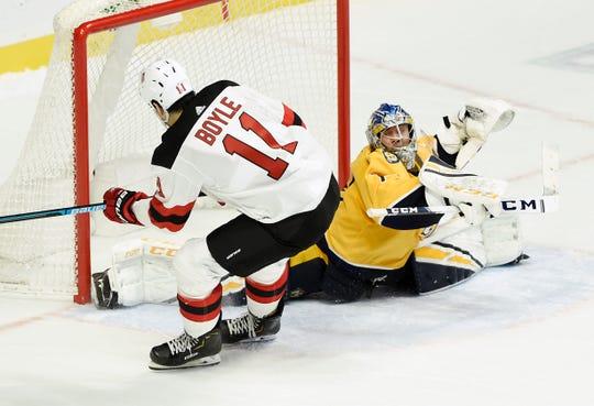 Nashville Predators goaltender Juuse Saros (74) blocks a shot by New Jersey Devils center Brian Boyle (11) in a shootout of an NHL hockey game Saturday, Dec. 15, 2018, in Nashville, Tenn. The Predators won 2-1.