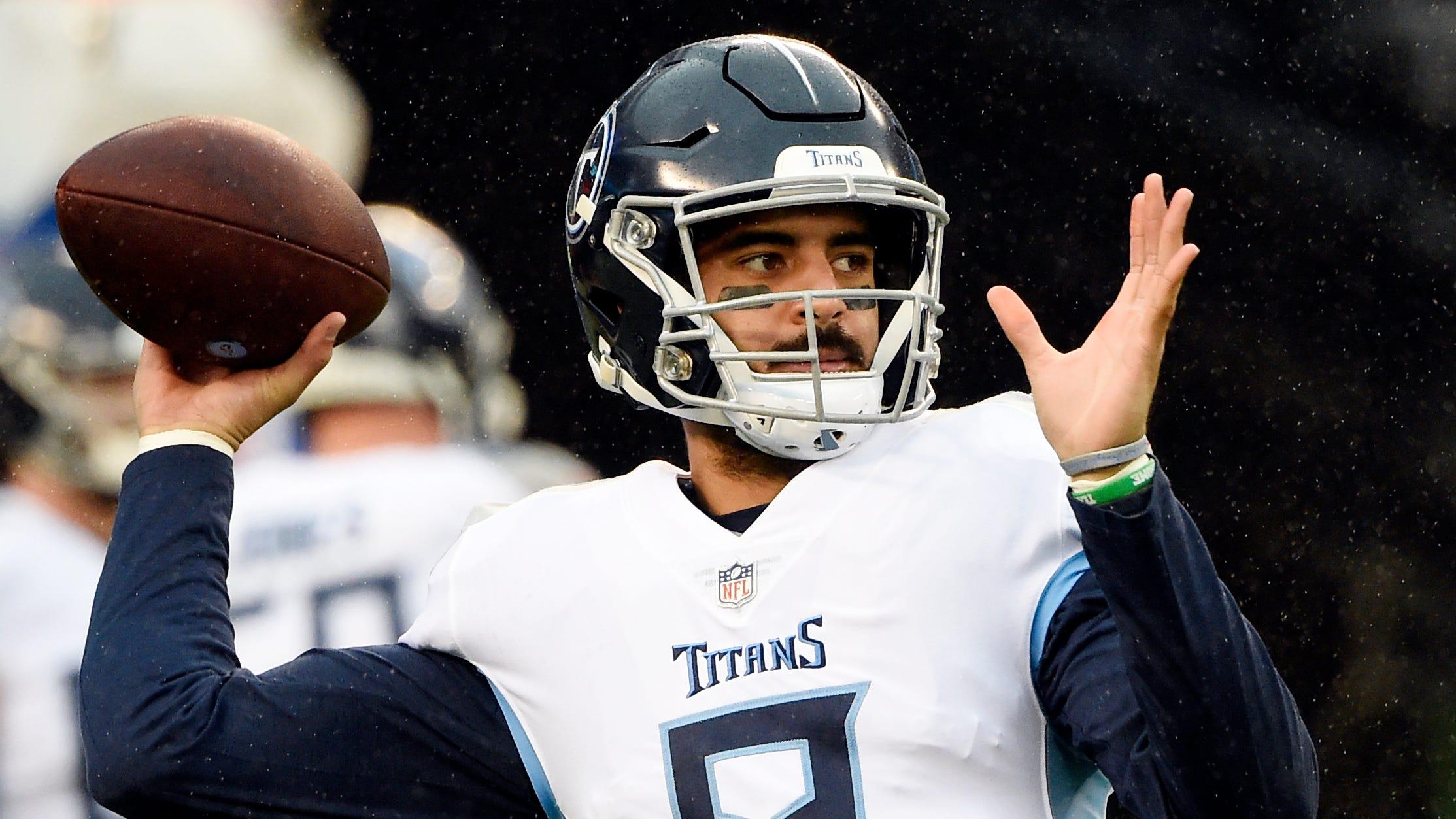 Titans quarterback Marcus Mariota (8) warms up...
