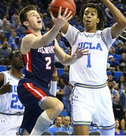 Belmont's Grayson Murphy shoots a layoff against UCLA in Saturday's game at Pauley Pavilion, which Belmont won 74-72.