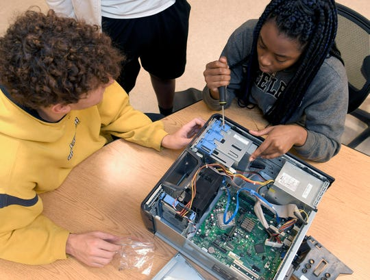 Overton High School sophmores Jack Alexander and A'nya Wilson put a computer back together duriung Computer Networking class on Dec. 13, 2018.