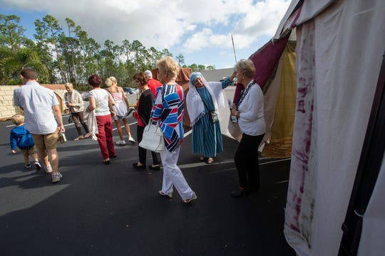 Guests are guided through a live nativity scene at St. Agnes Catholic Church on Sunday, Dec. 16, 2018, in East Naples.